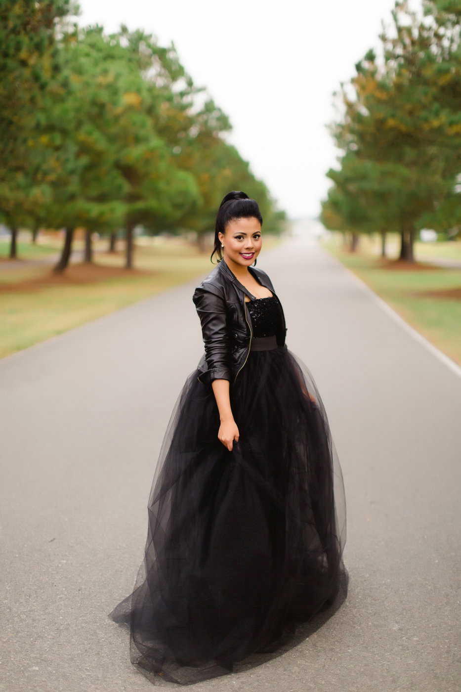 elopement outfit inspiration bride in black gown and leather jacket