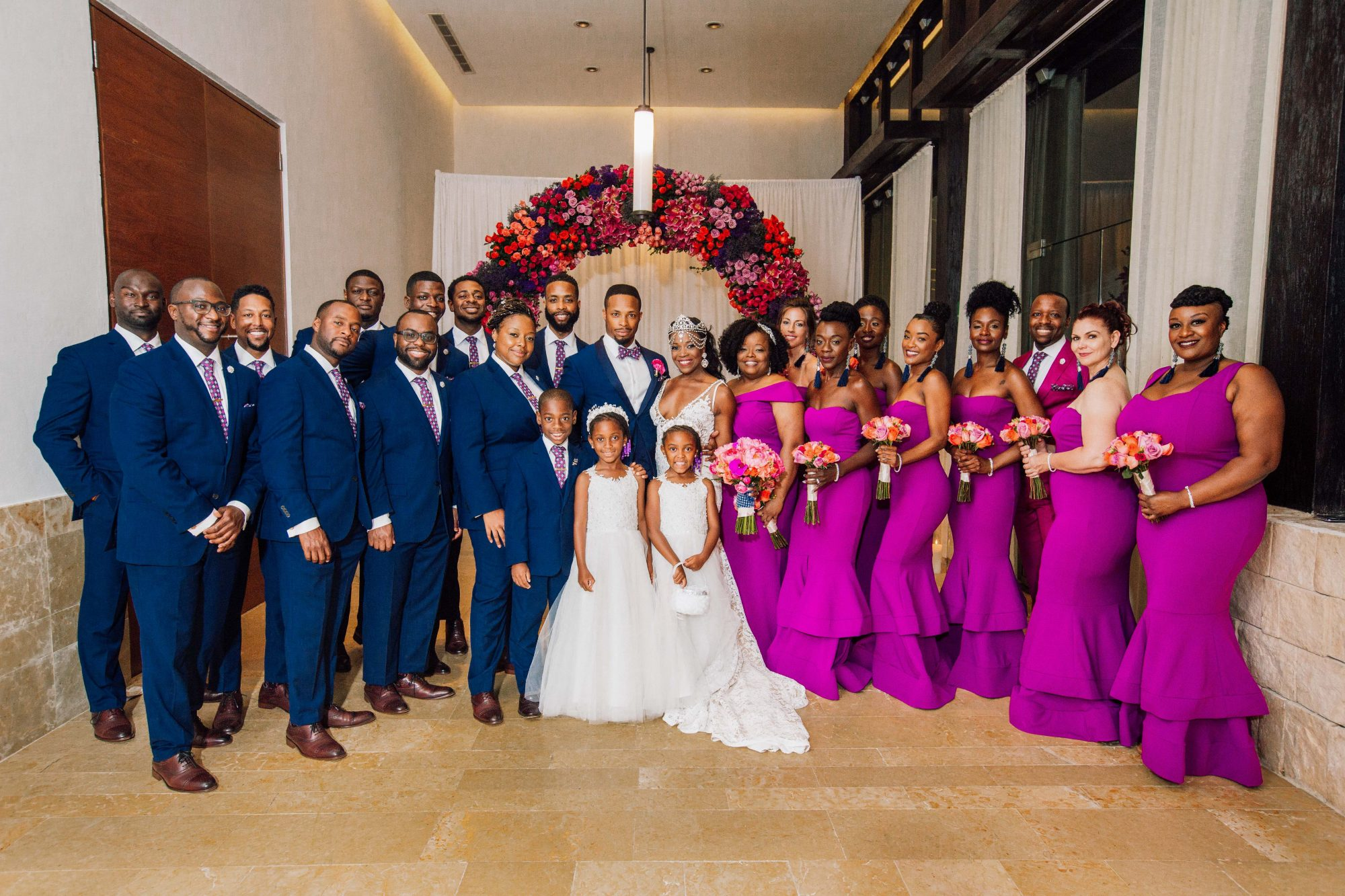 bride and groom wedding party navy tux pink dresses