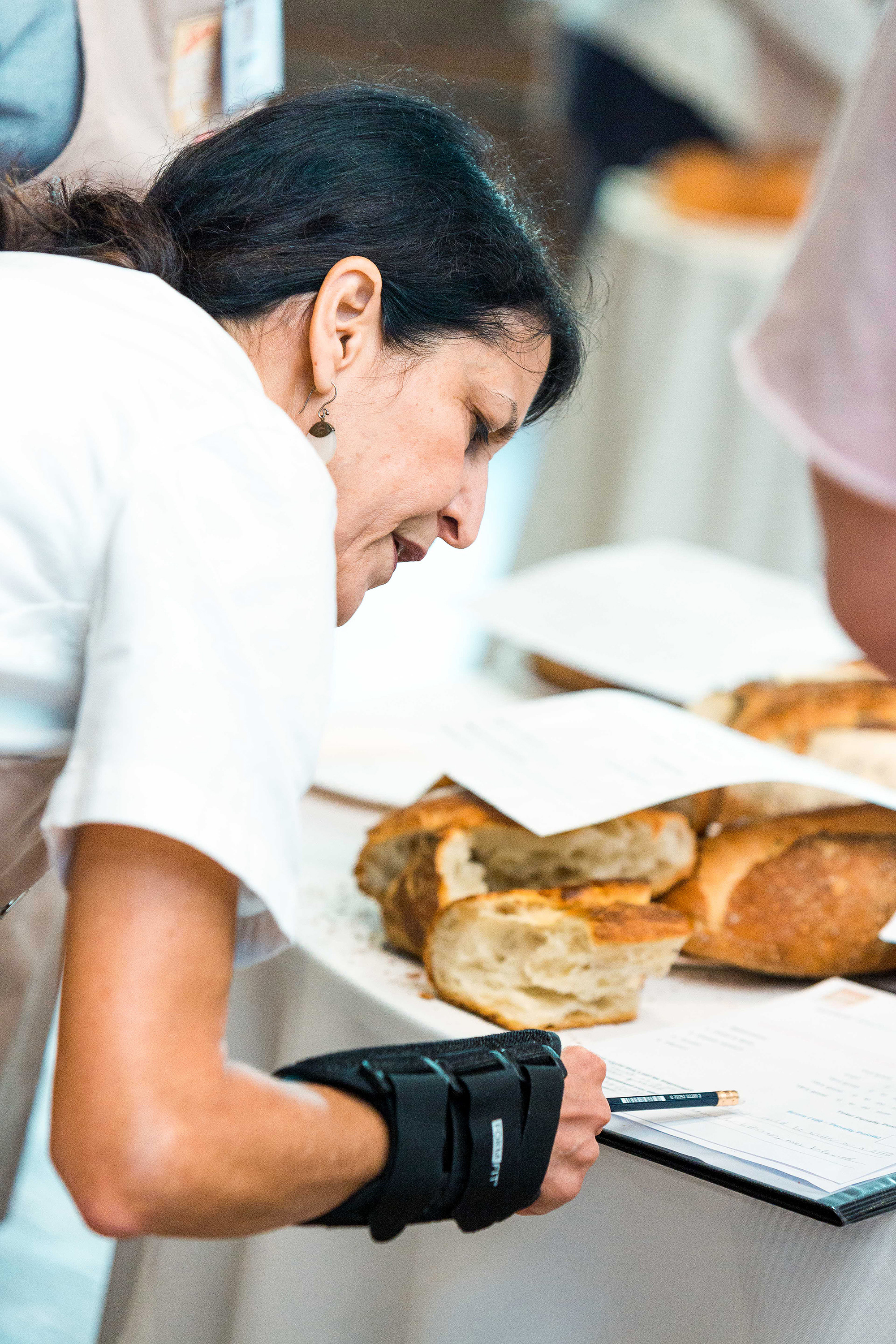 world bread awards usa judging woman scrutinizing entry