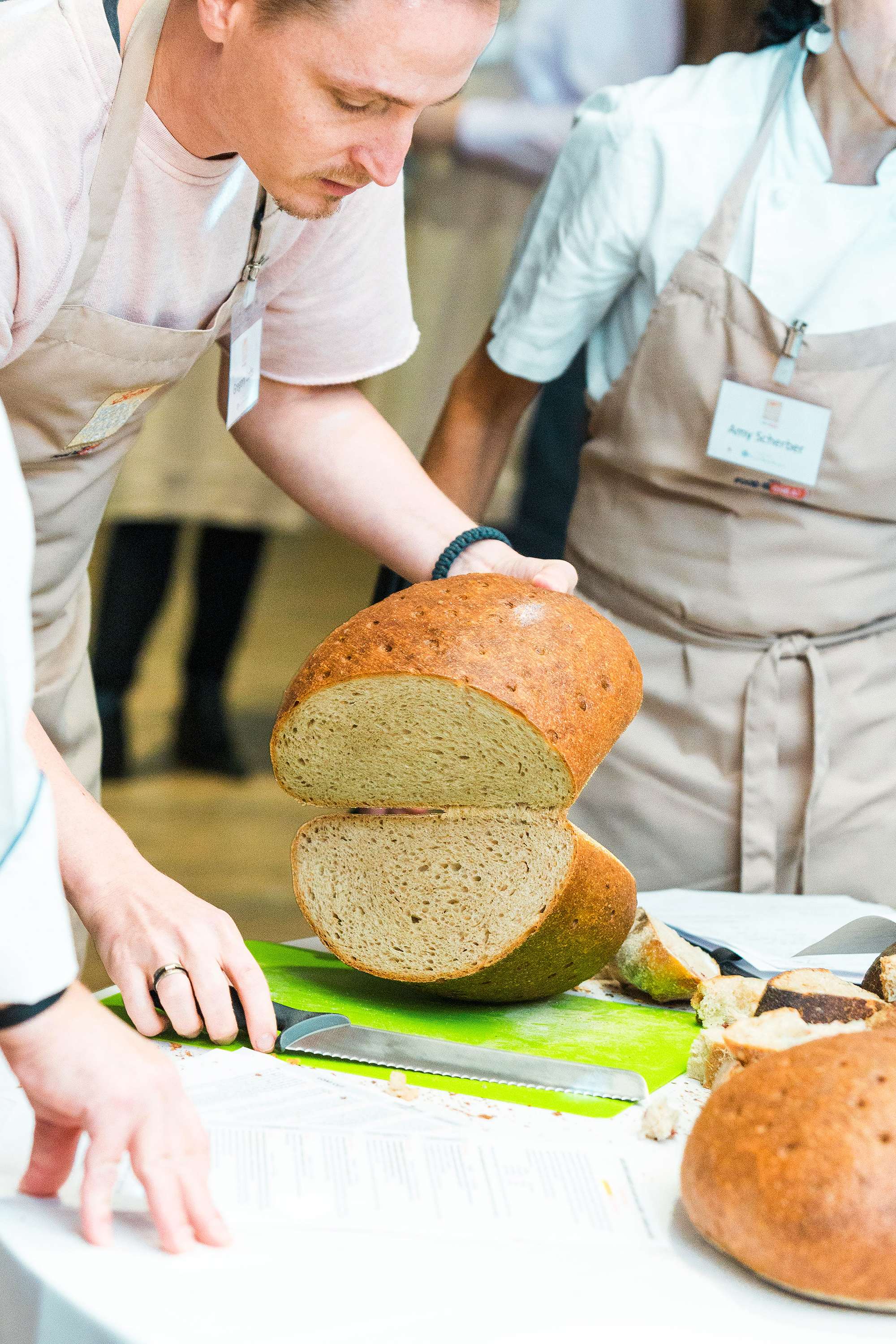 world bread awards usa judging man cutting open entry