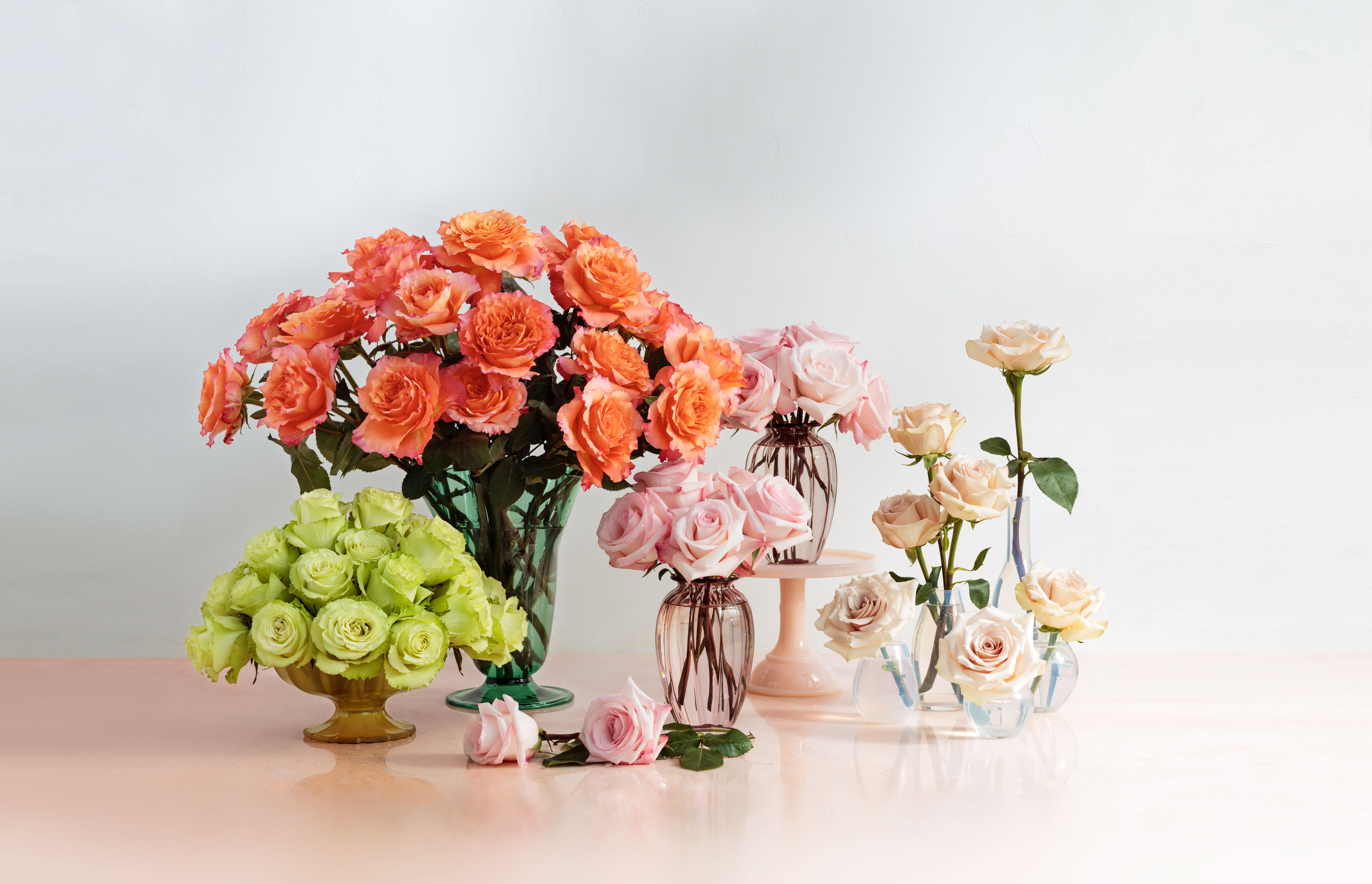 multiple vases of assorted roses