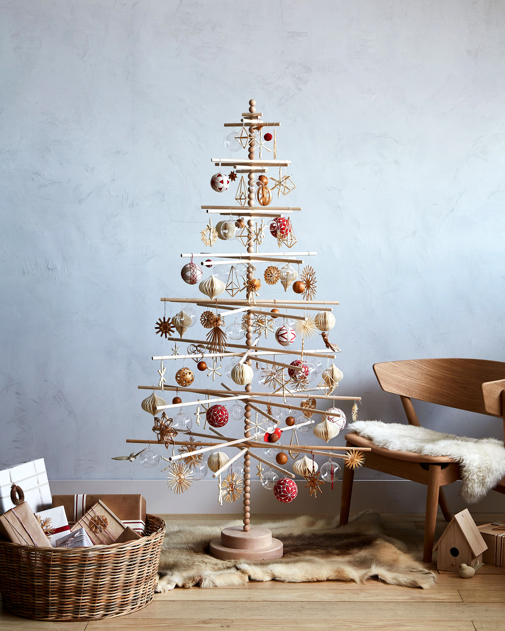 scandinavian christmas tree with wooden ornaments in living room