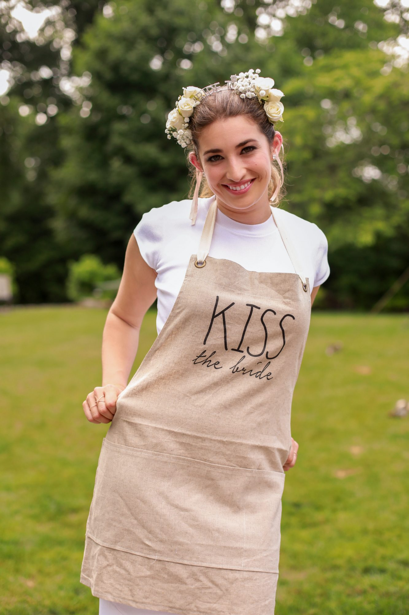 bridal shower bride with kiss the bride apron
