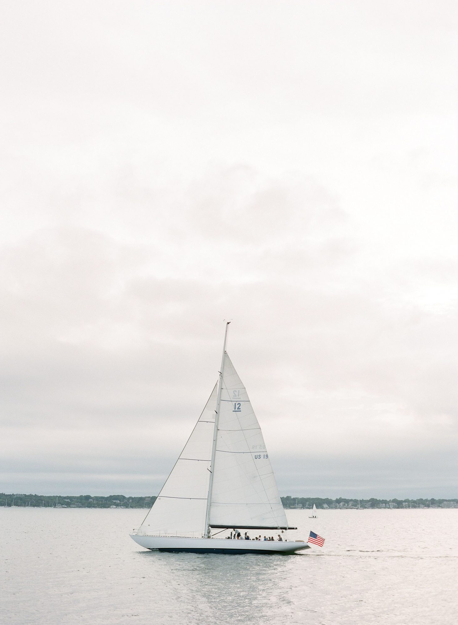 colleen stephen newport wedding sailboat with american flag