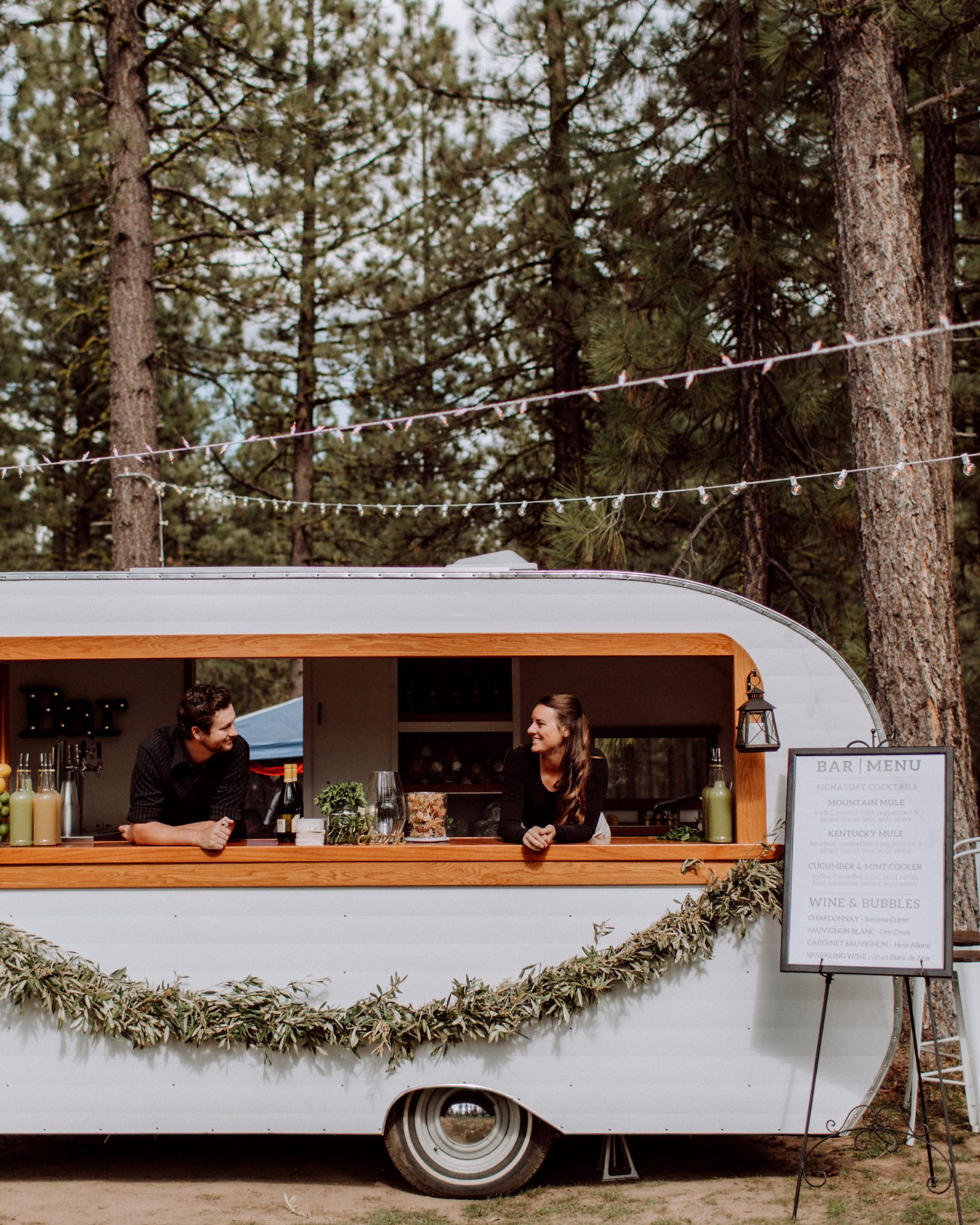 Court & Kelsey's mobile bar parked in trees