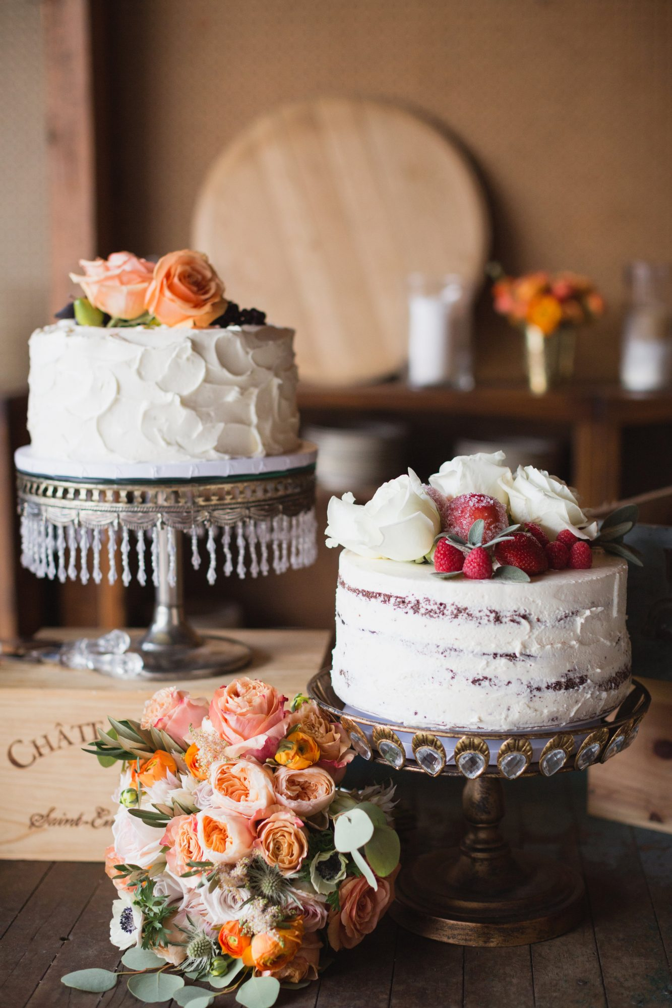 simple white with floral topping wedding cakes