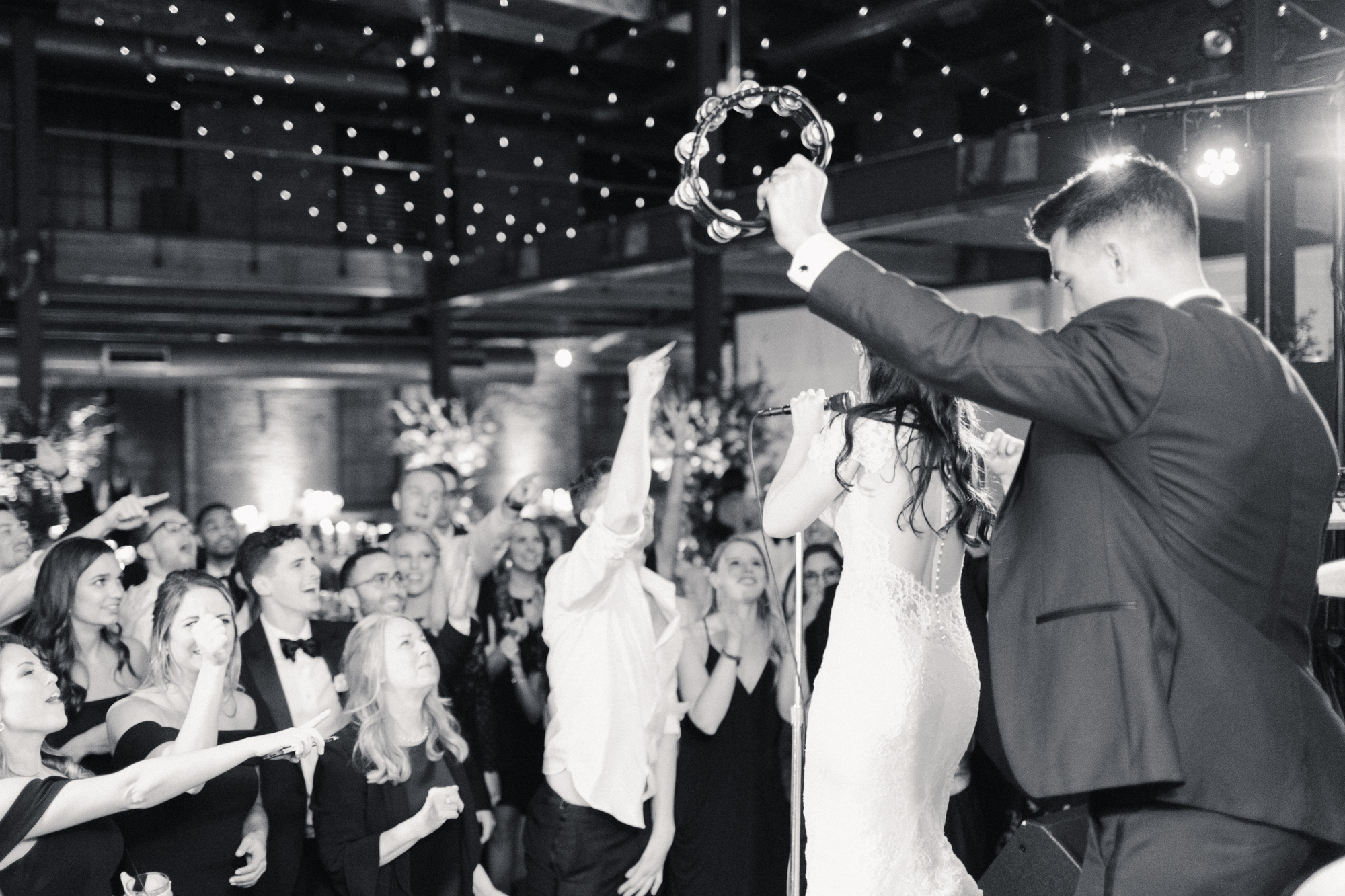 wedding couple performing on stage for guests