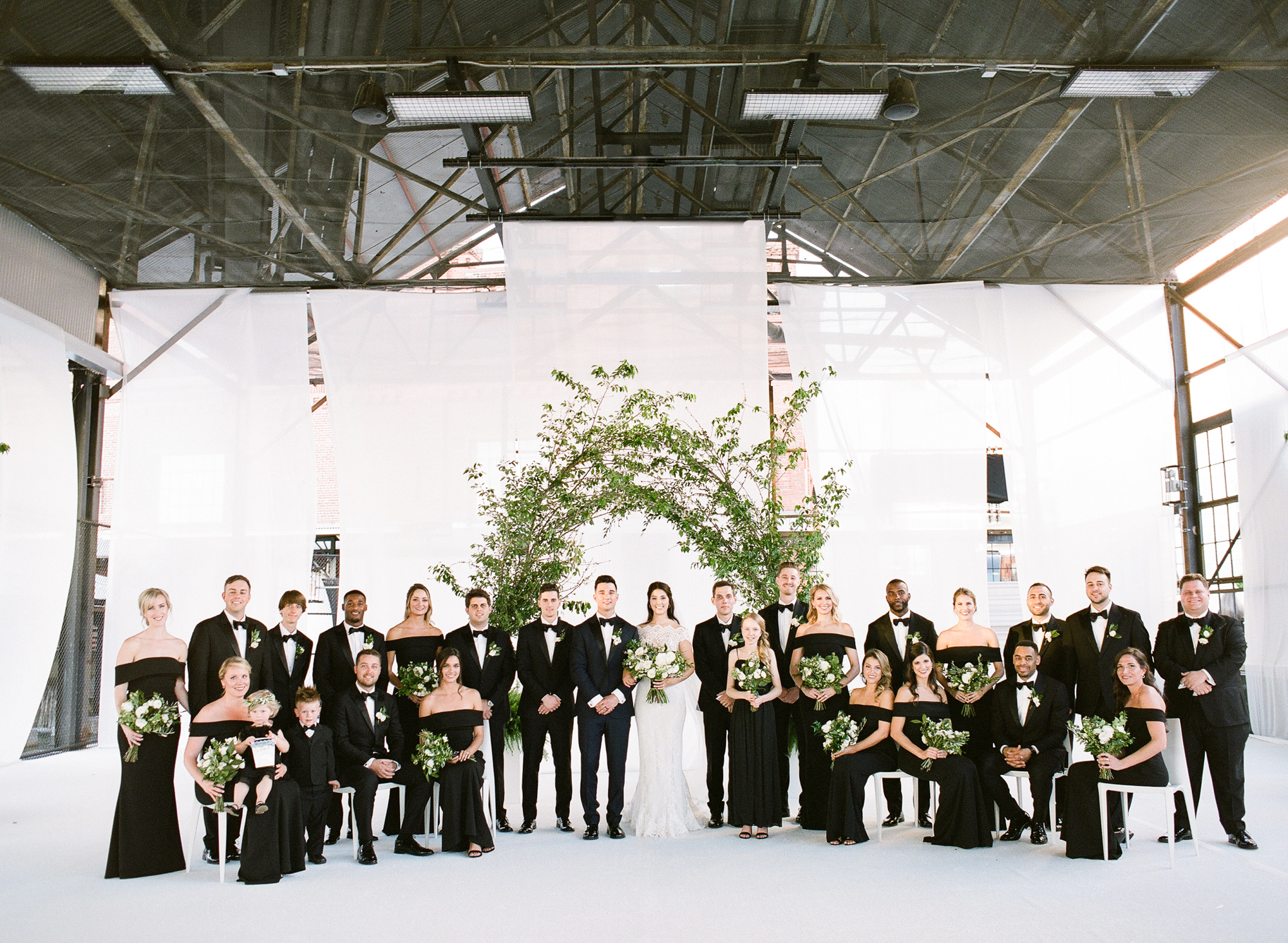 wedding party group shot white back drop