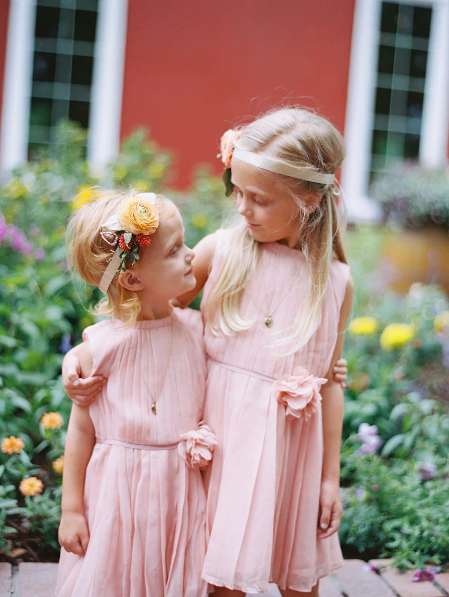 two flower girls wearing pink dresses