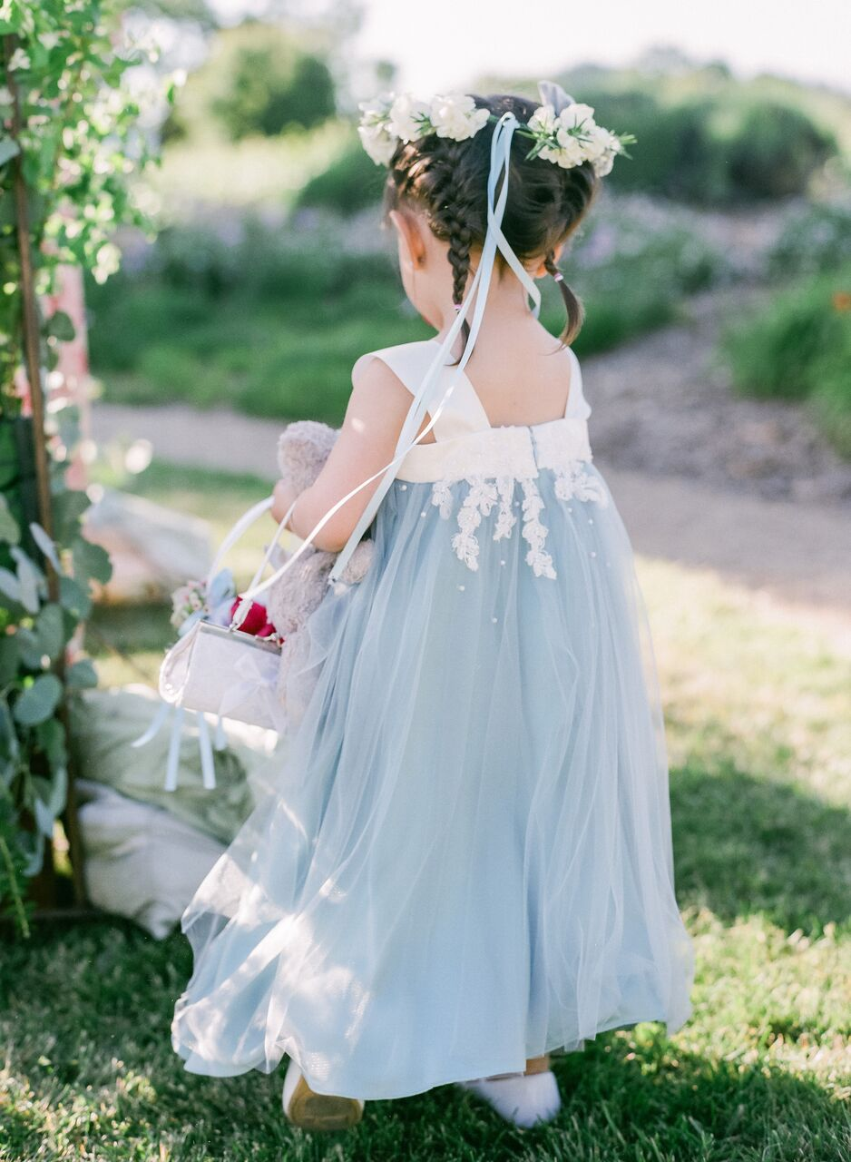 flower girl wearing blue and white dress