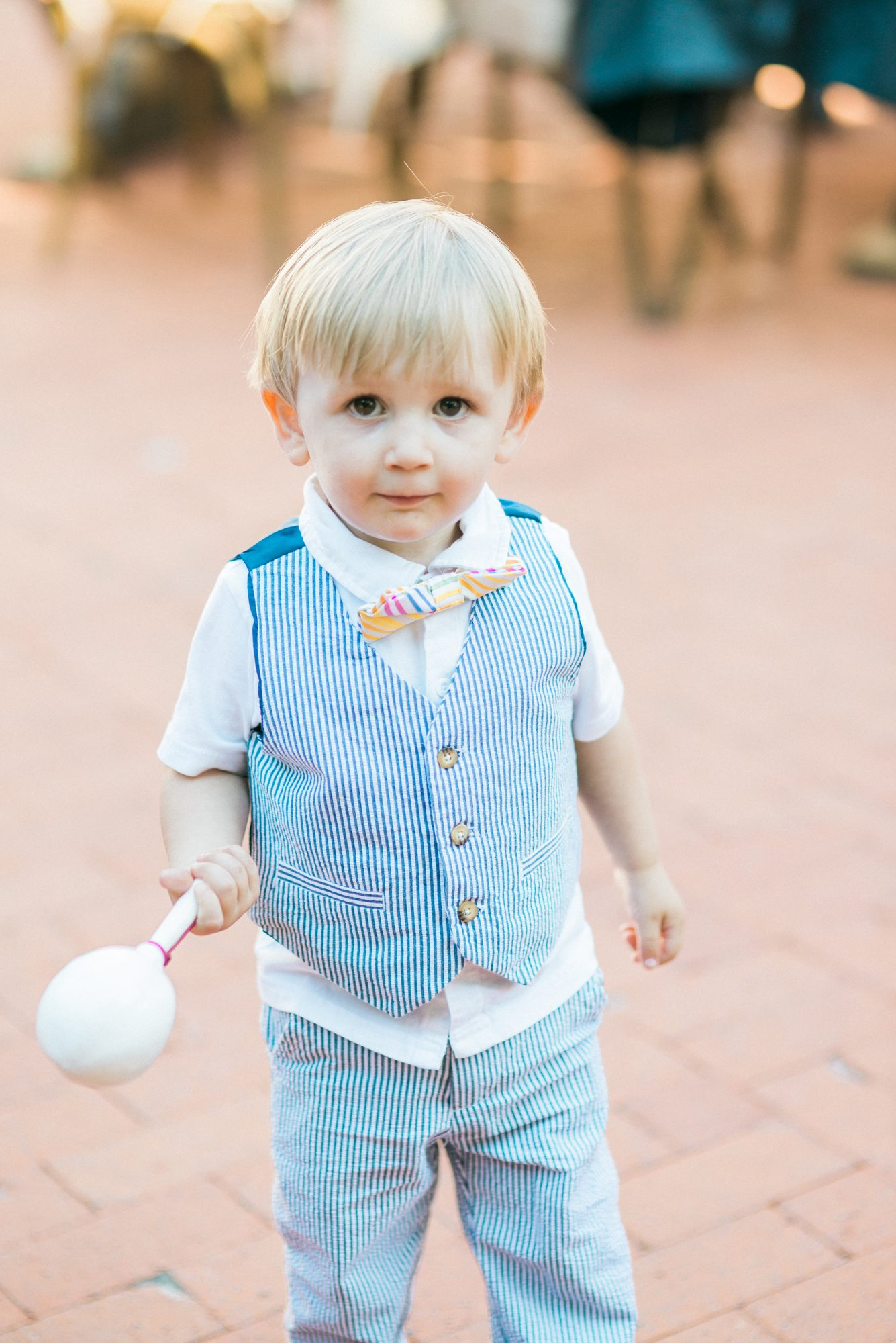 ring bearer wearing striped vest and pants