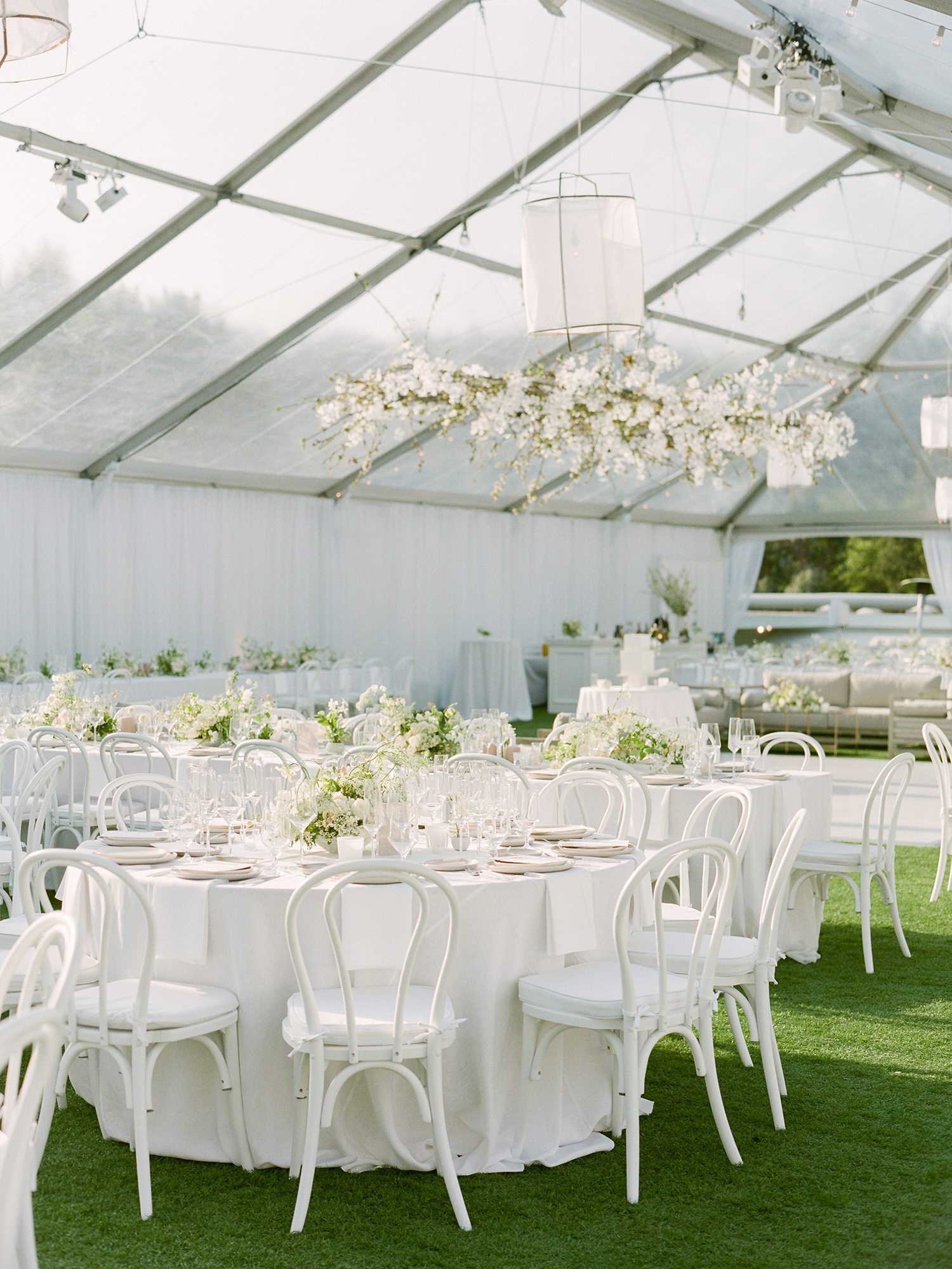 grace ceron wedding round tables in glass tent