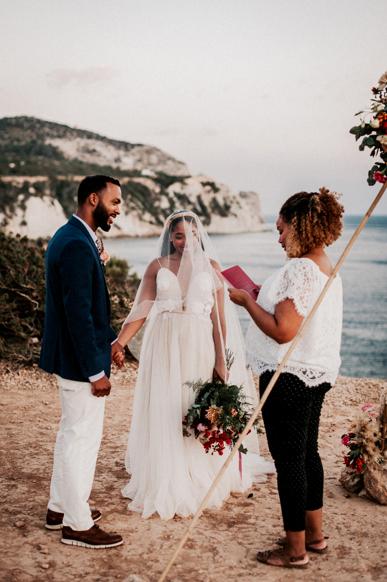 couple exchanges vows near water overlooking island