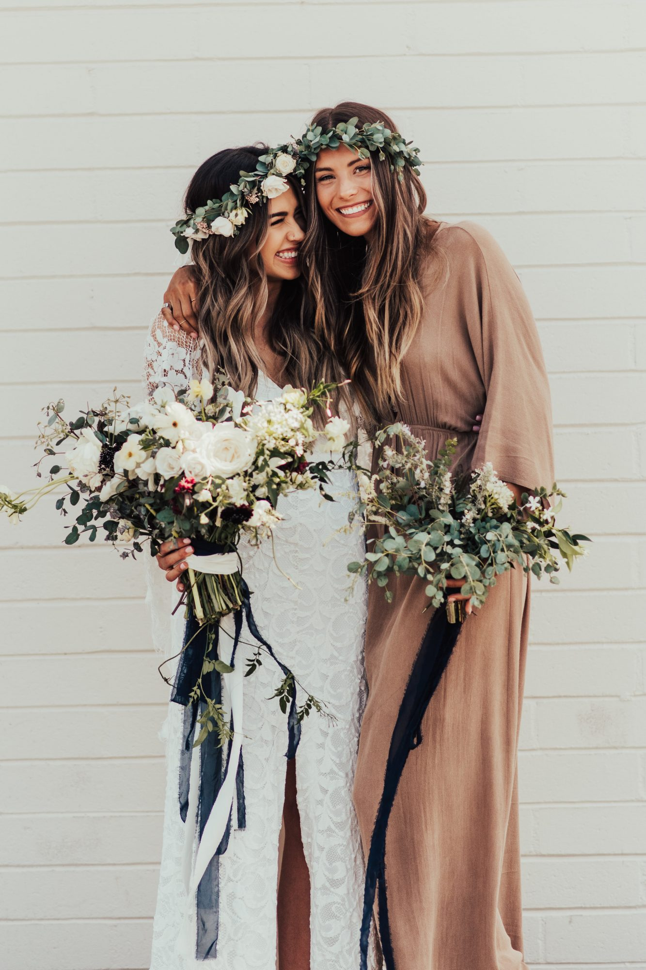bride and maid of honor wearing matching headpieces