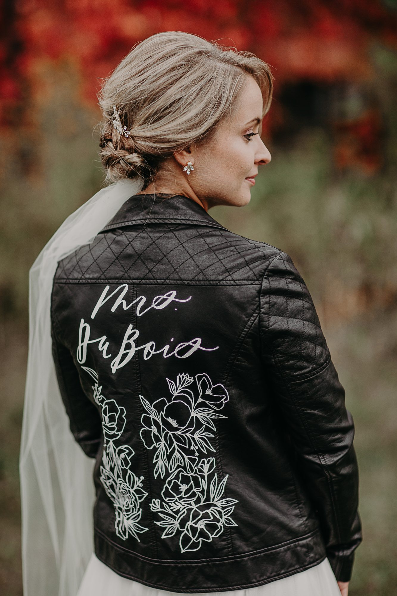 leather jacket with painted picture and name