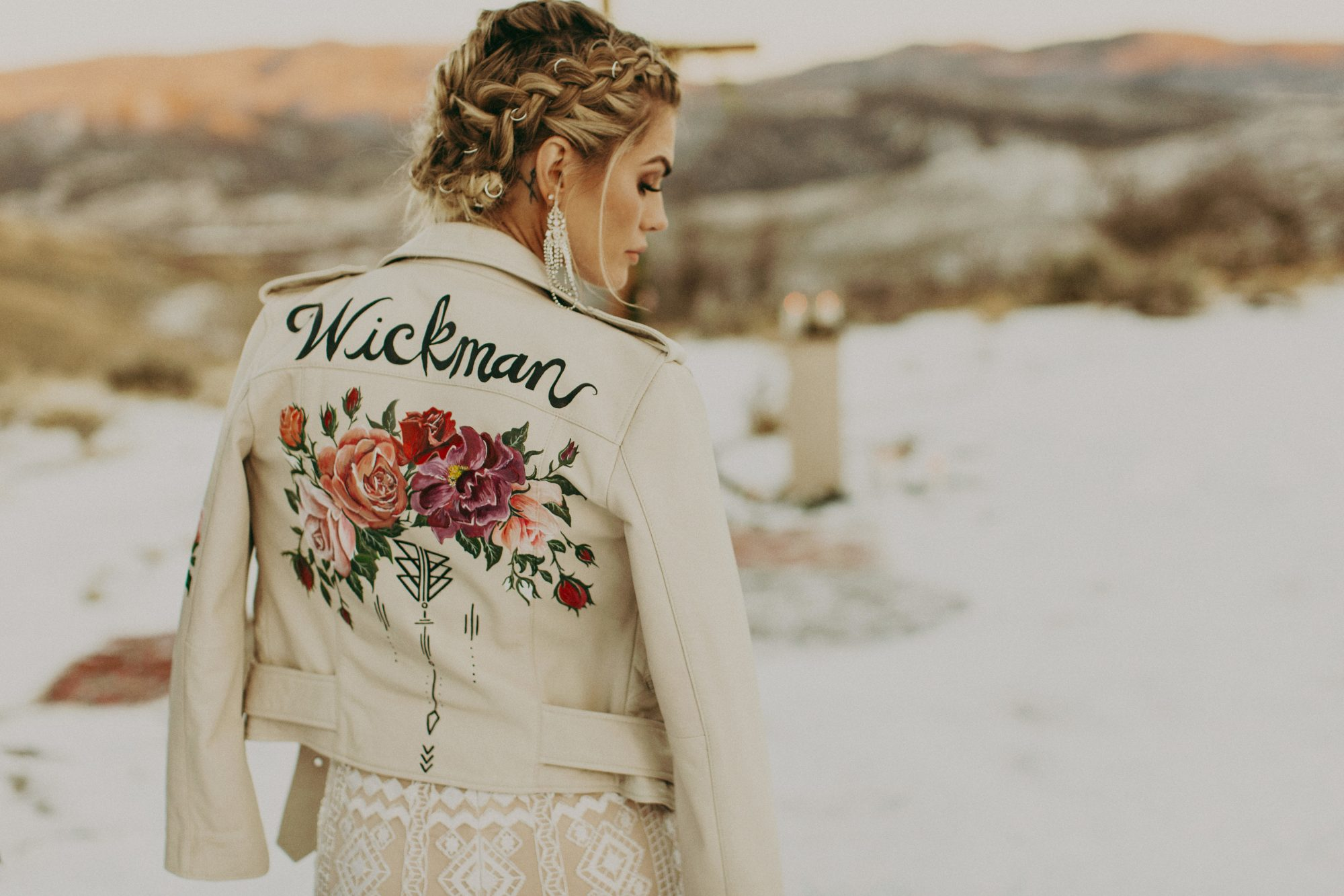 white leather jacket with painted flower and name