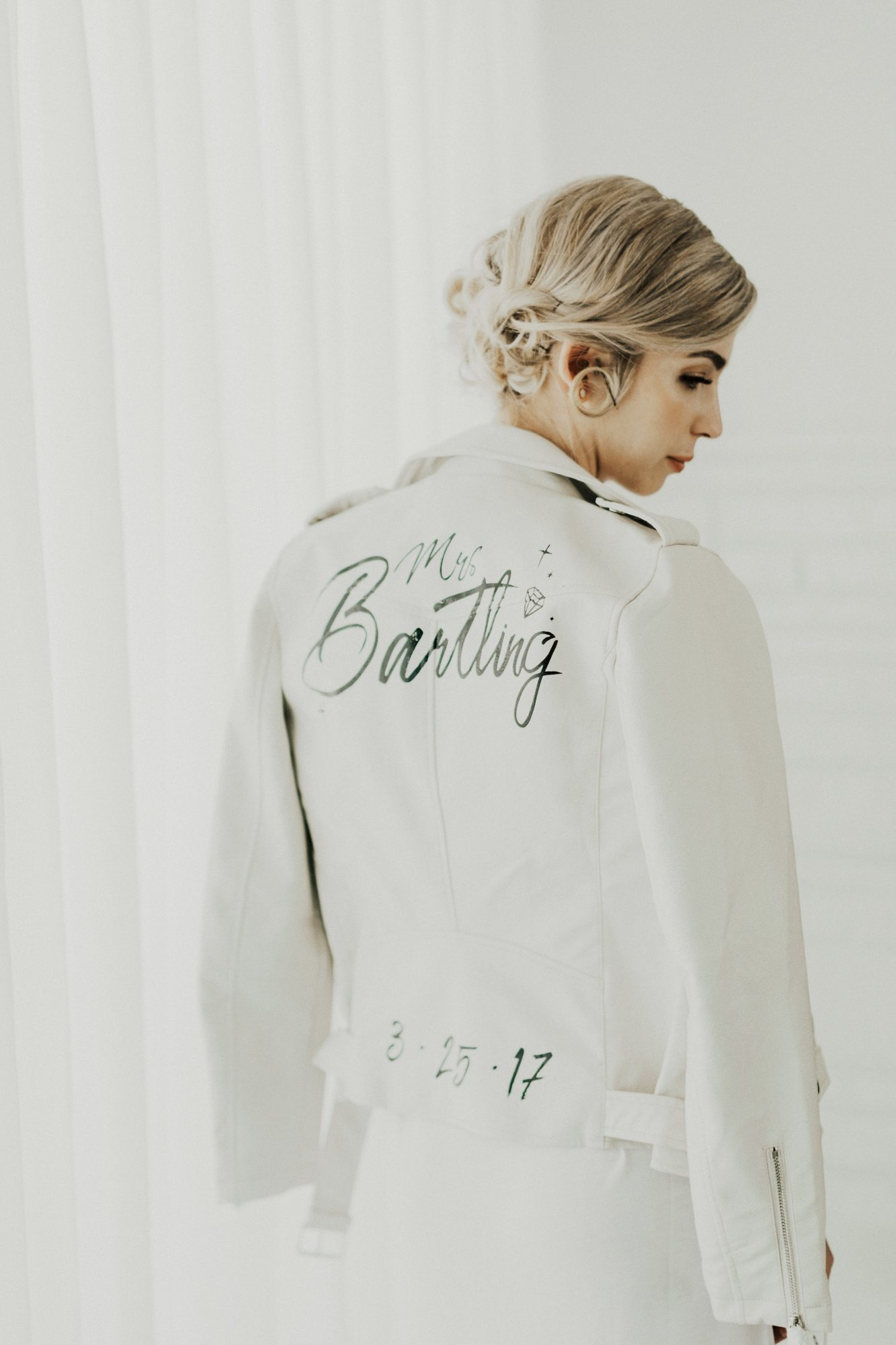 white leather jacket with date and name