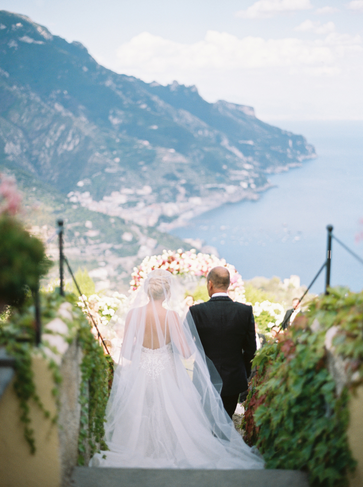 allie and joe italy wedding processional bride and her father overlooking view