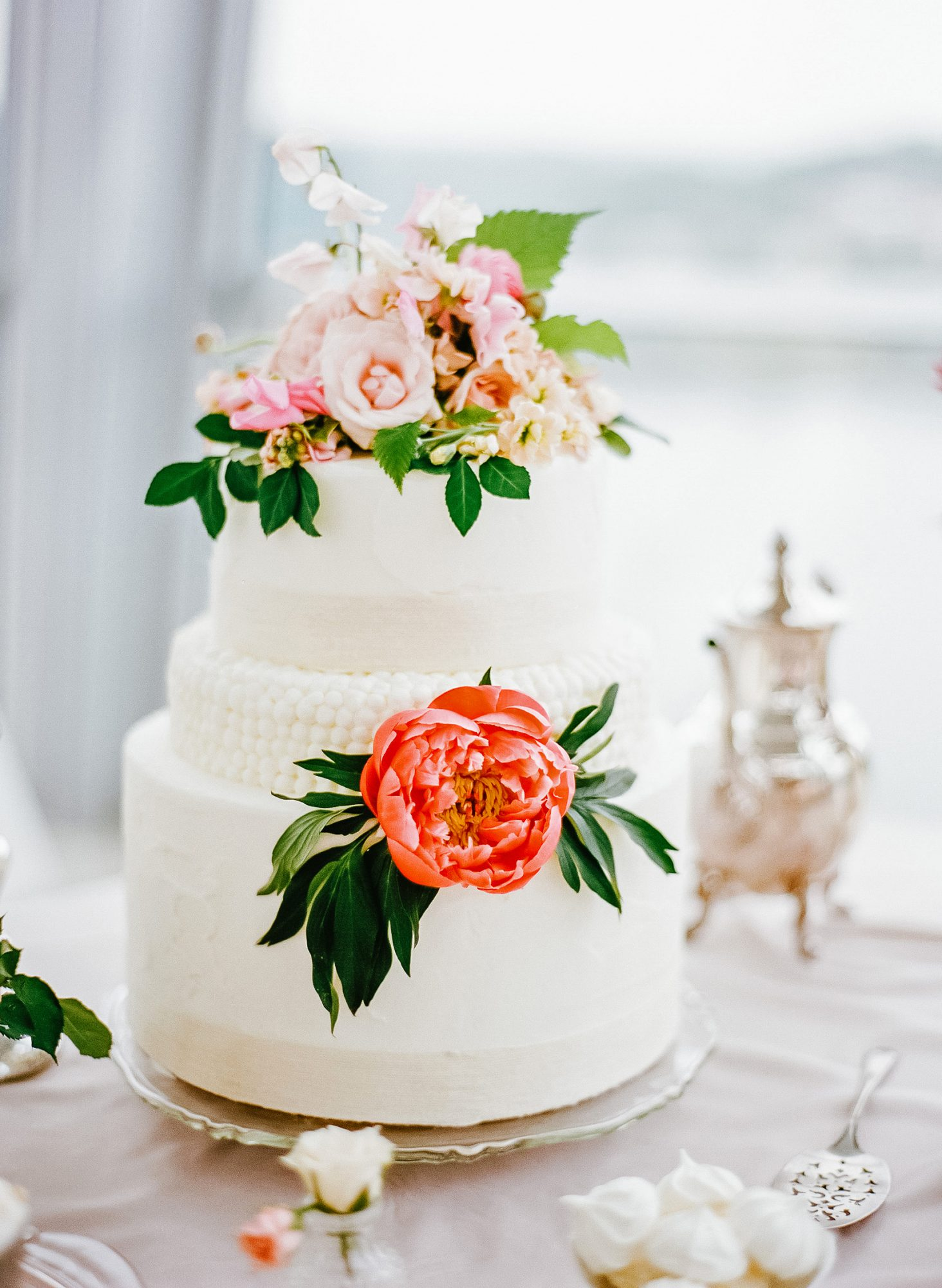 micro tier wedding cakes textured with orange and pink flowers