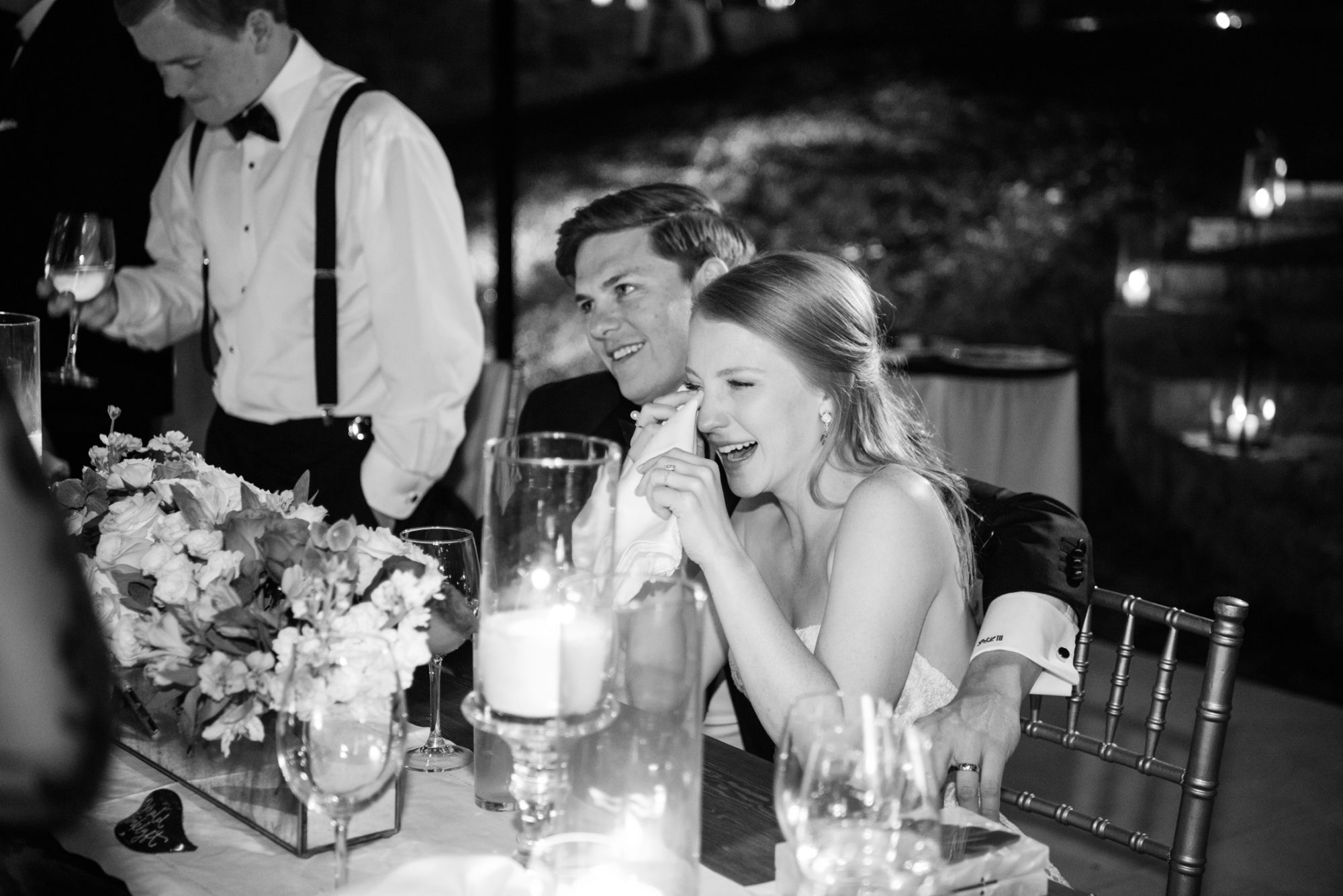 bride tearing up during wedding toasts