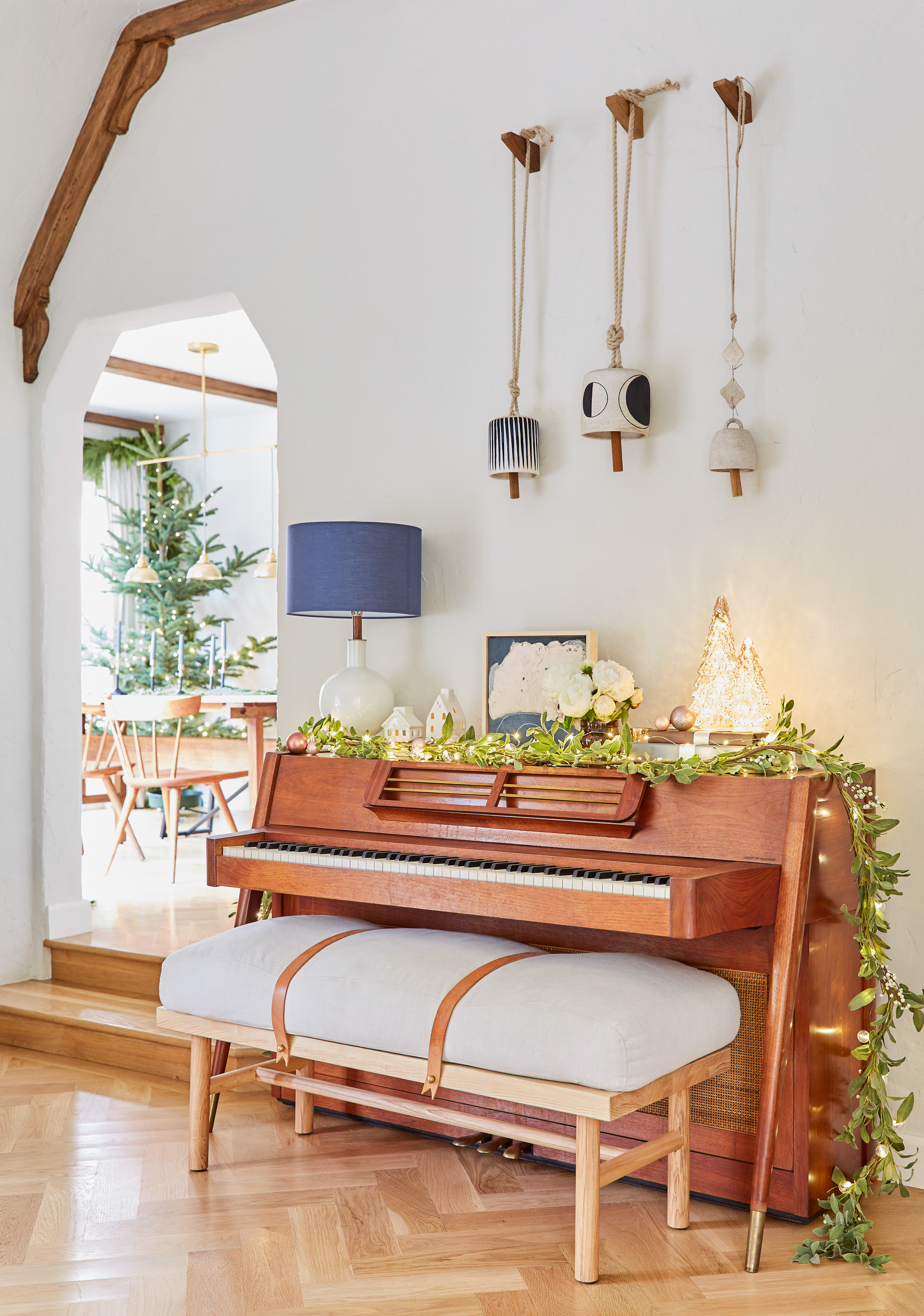 emily henderson holiday decor piano with garland