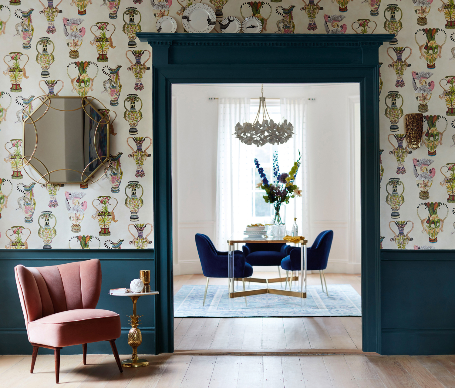 pink accent chair and floral wallpaper