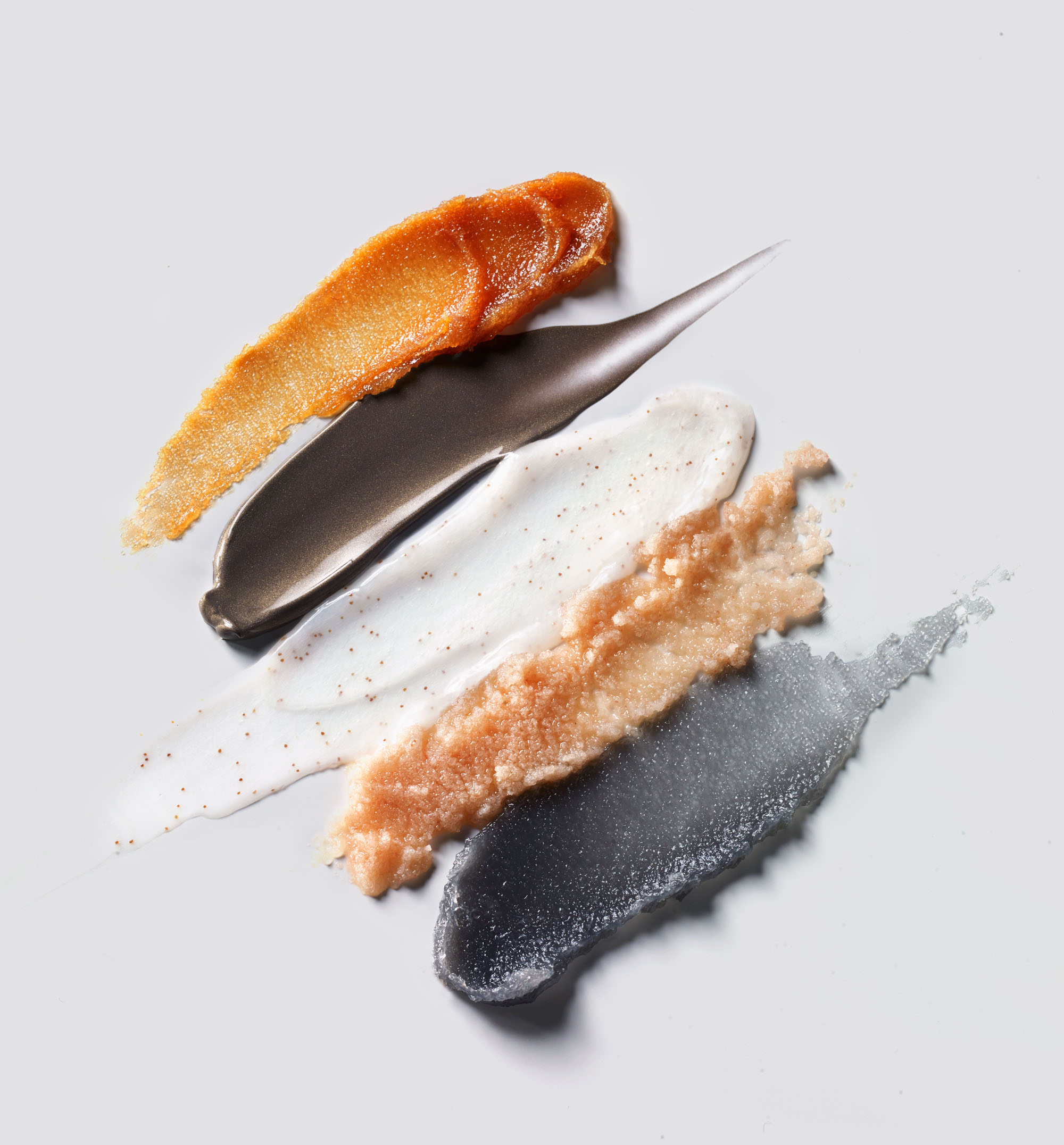comparing swatches of exfoliants