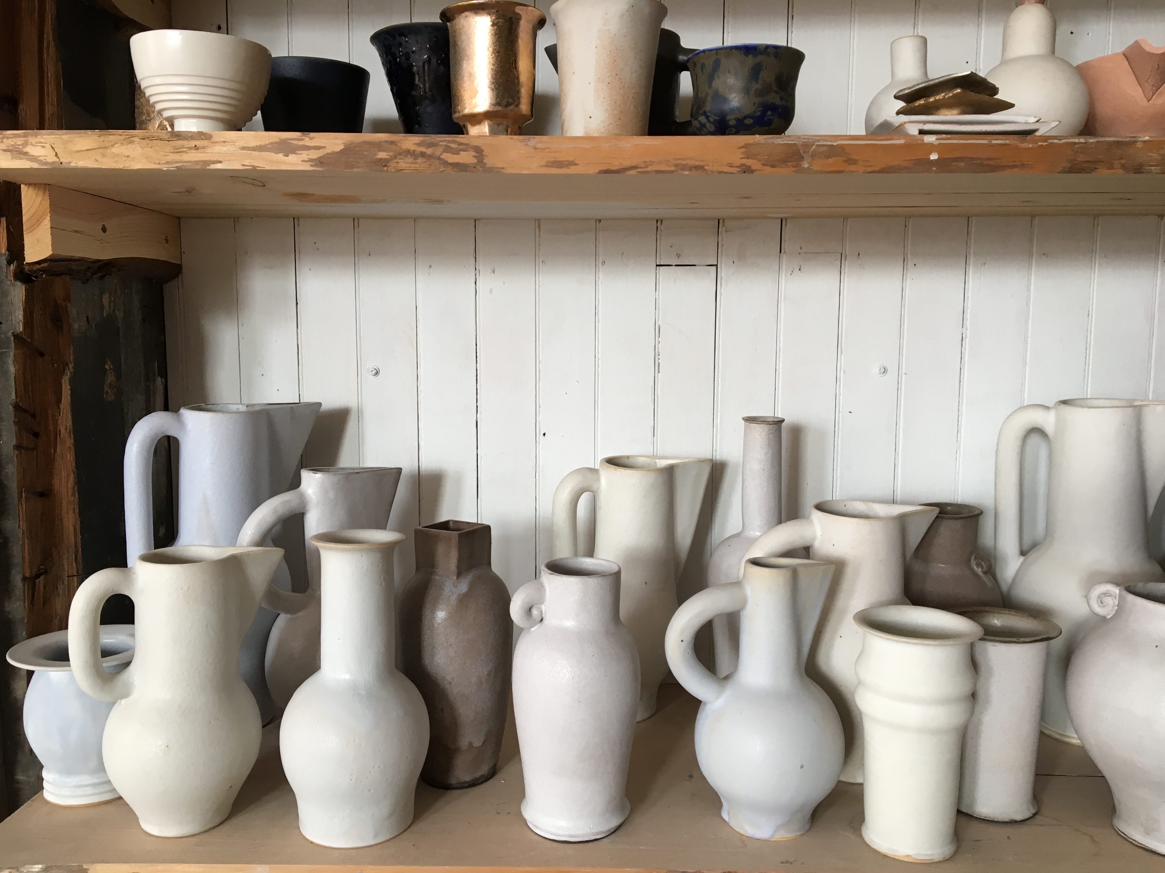 white ceramic vessels on shelf