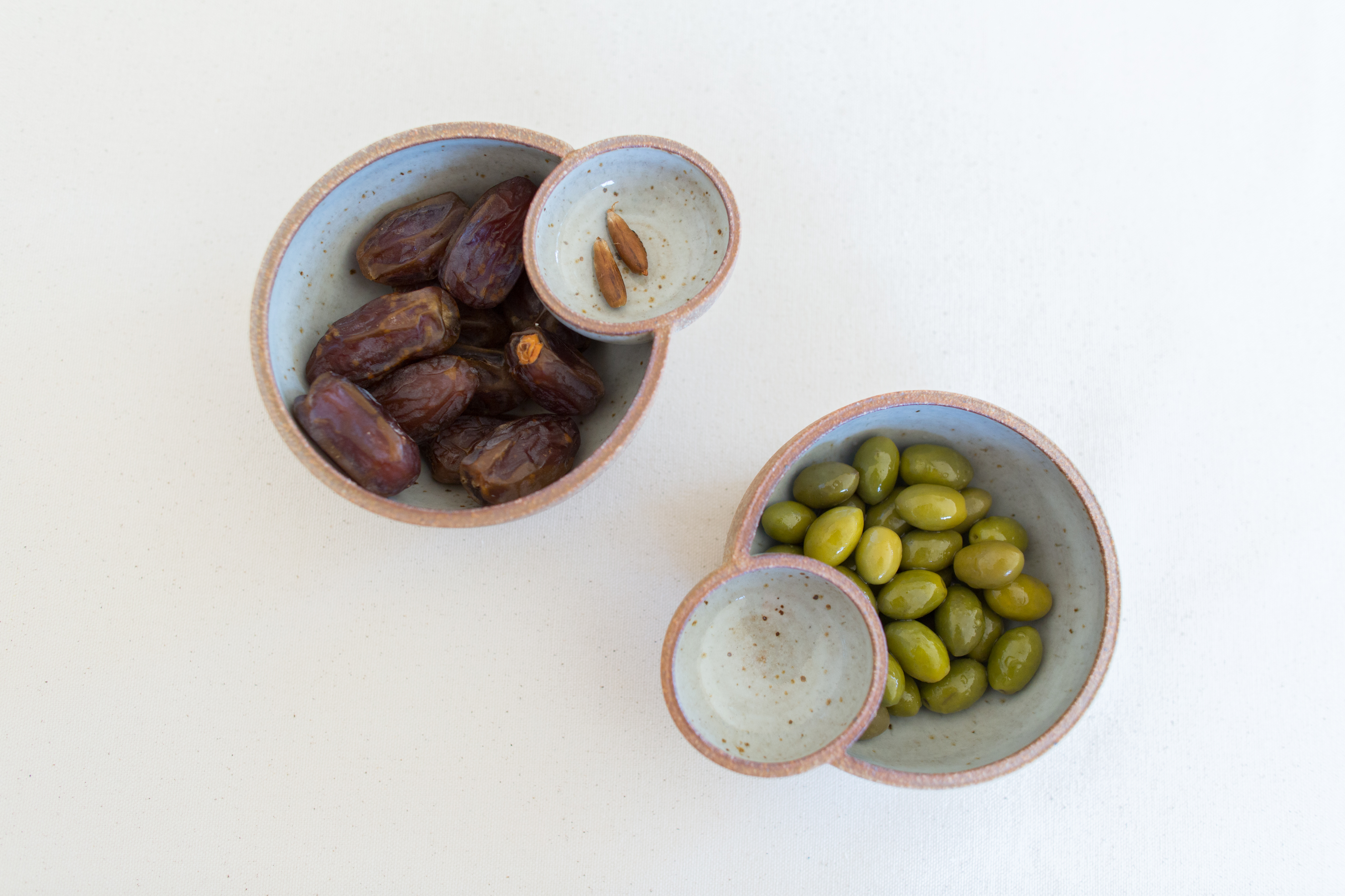 ceramic food bowls with olives and dates