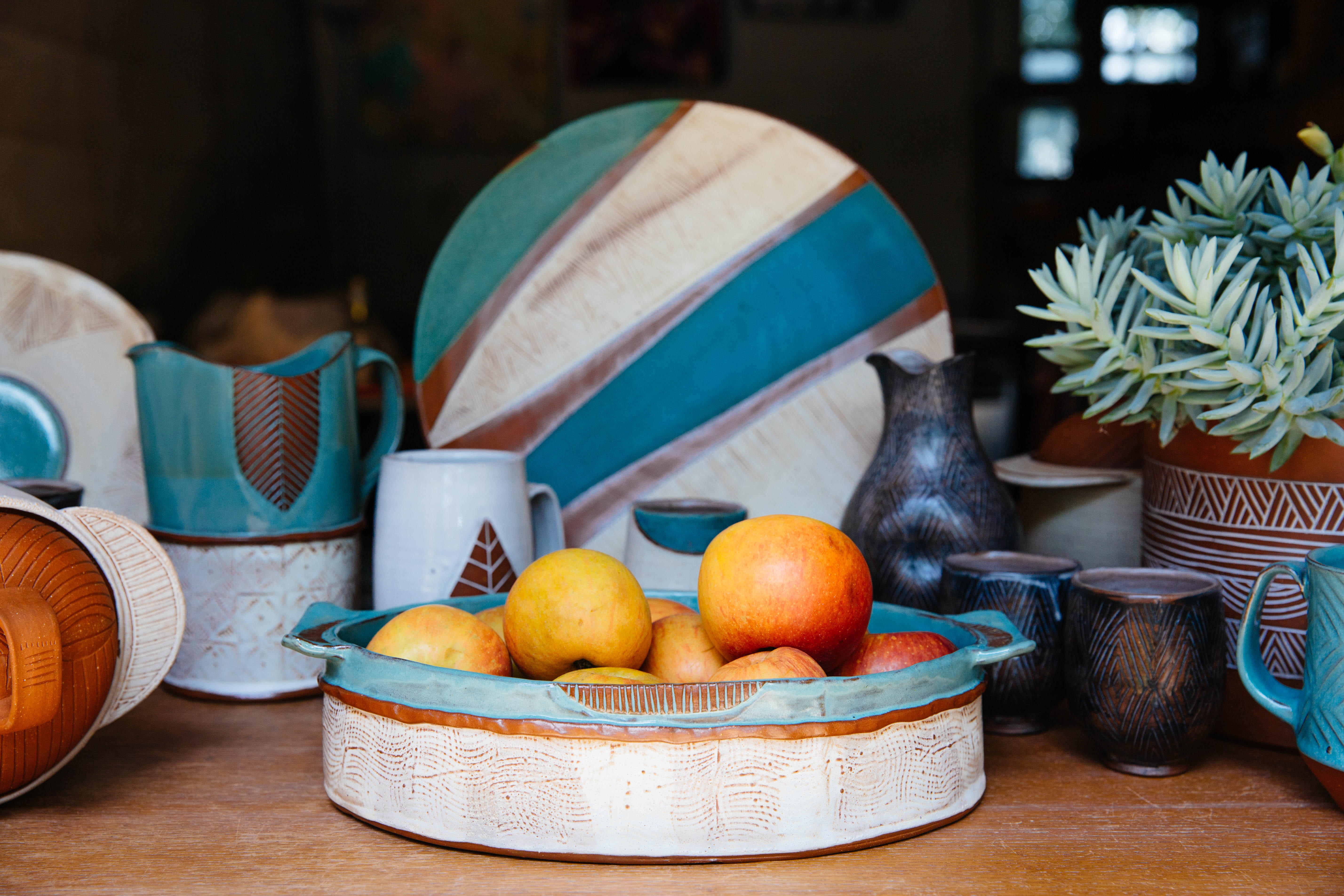turquoise ceramic pottery with oranges
