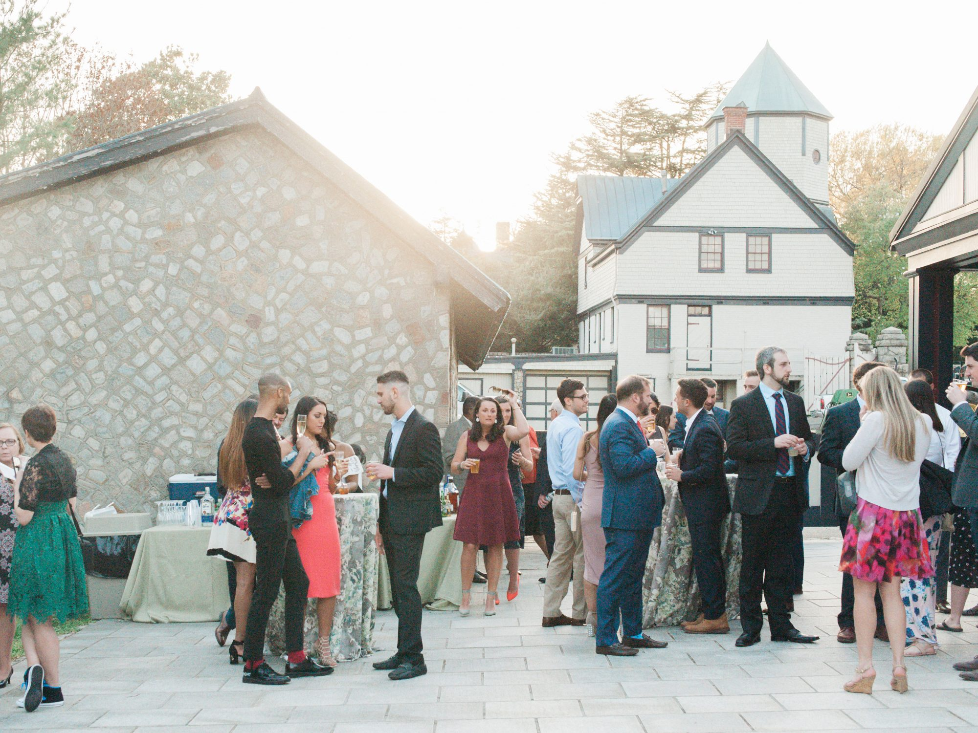wedding guests enjoying outdoor cocktail hour