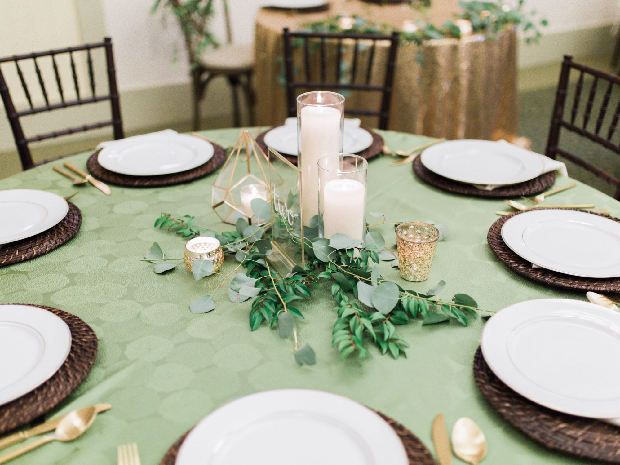 wedding reception table setting candle greenery centerpiece