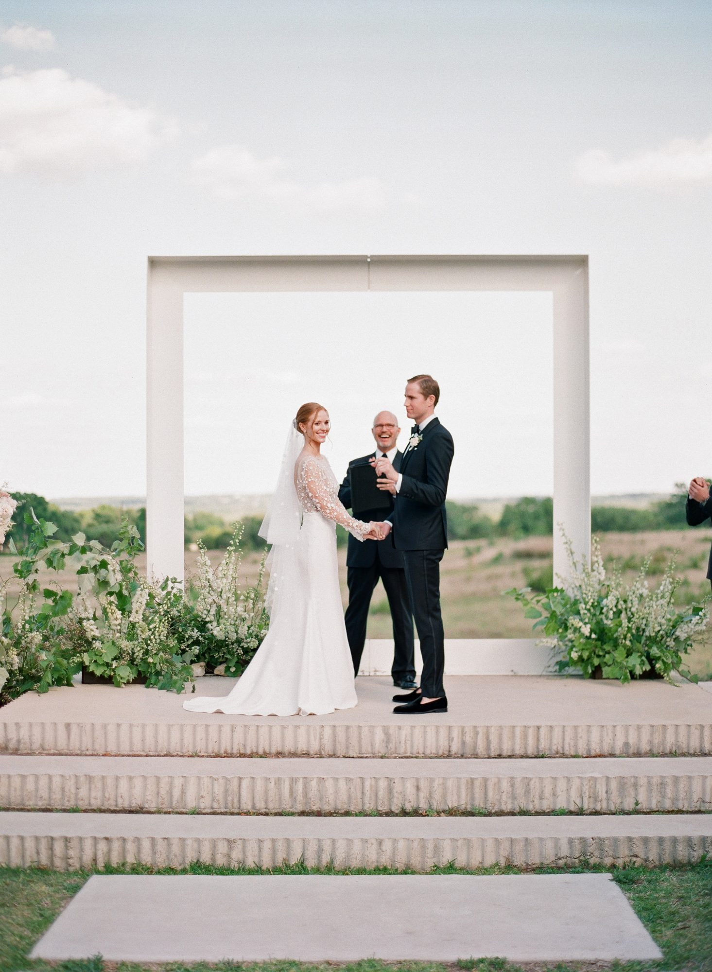 brittany peter wedding ceremony bride and groom and officiant
