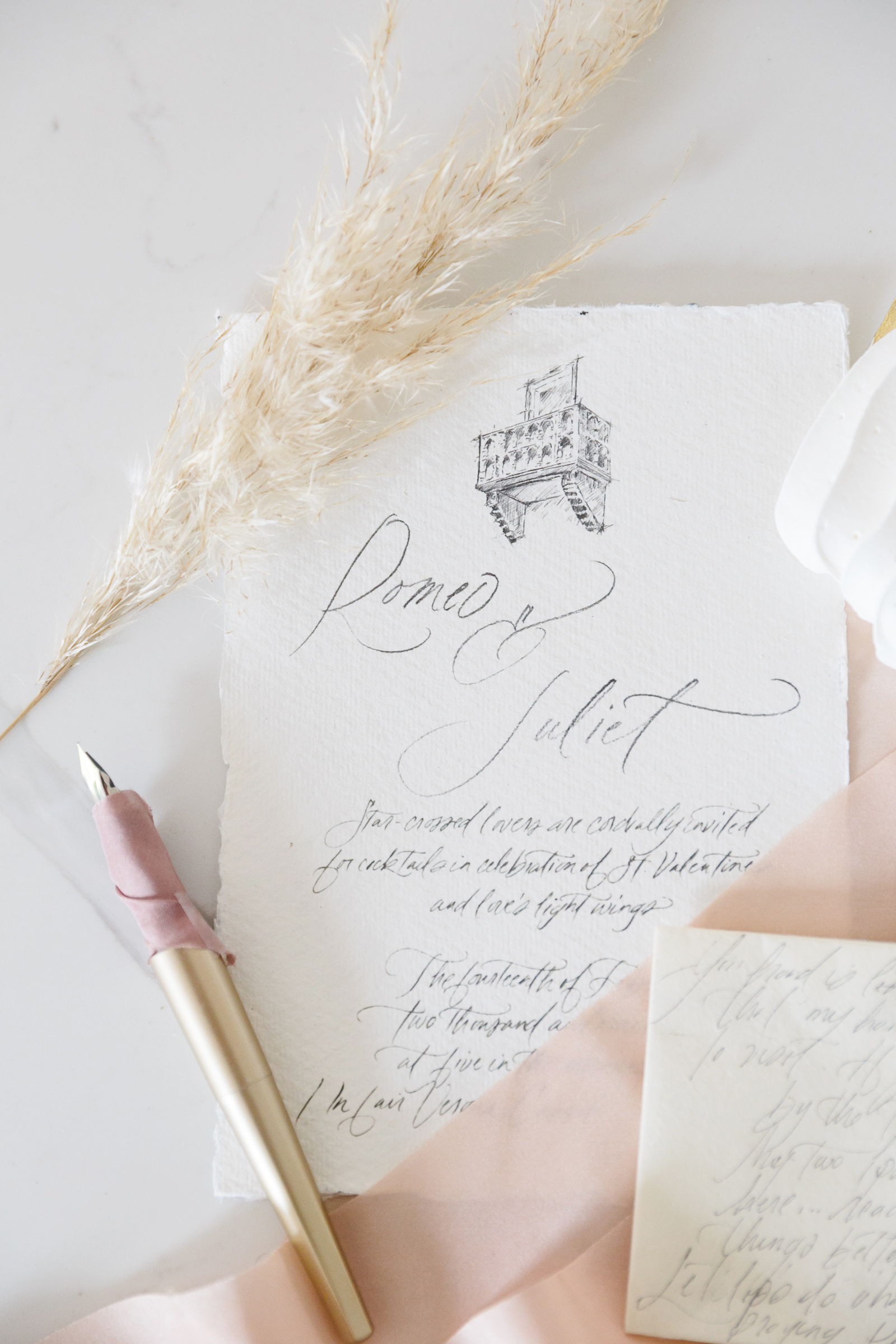 romeo and juliet valentines day party invitation with a pink ribbon and calligraphy pen
