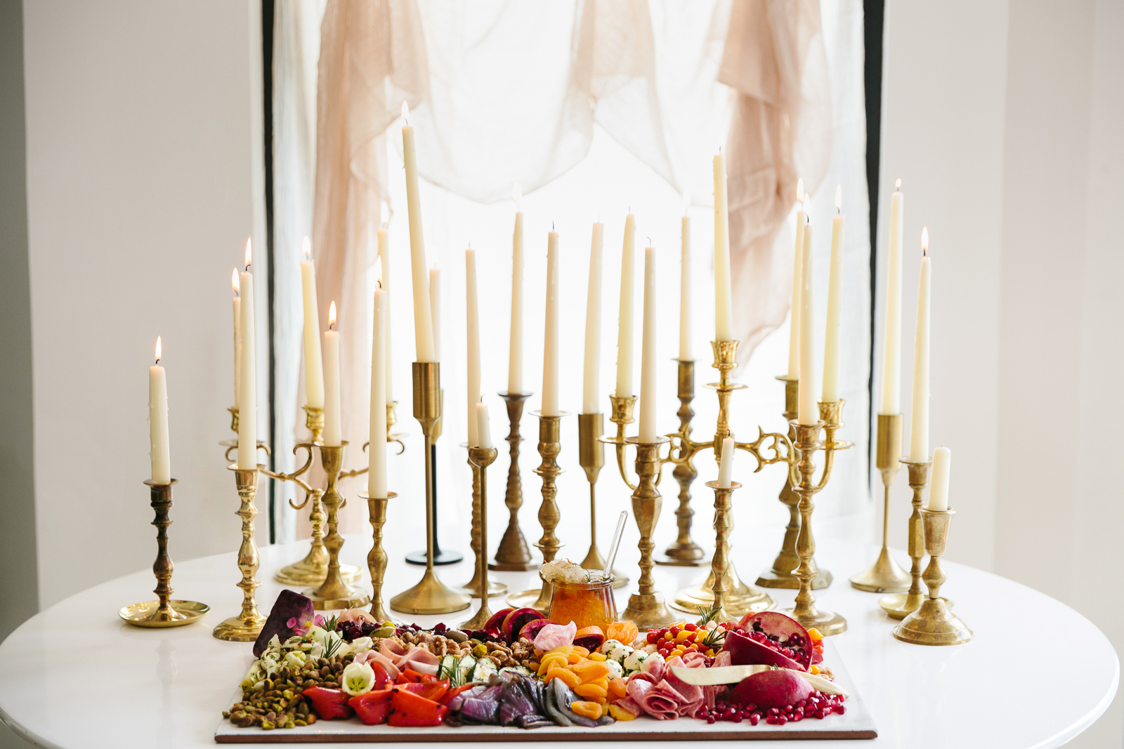 romeo and juliet valentines day party table with smorgasbord and gold candles
