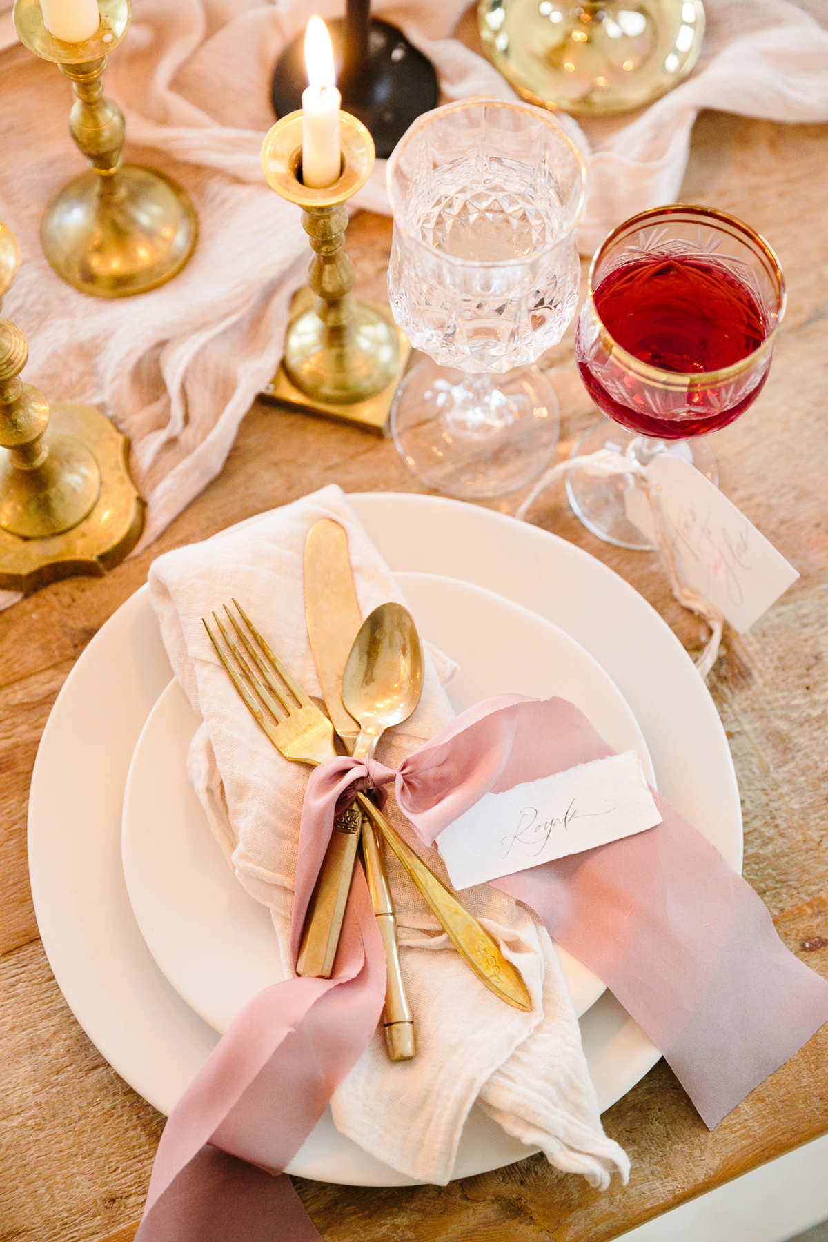 romeo and juliet valentines day party place setting with pink plates and gold silverware