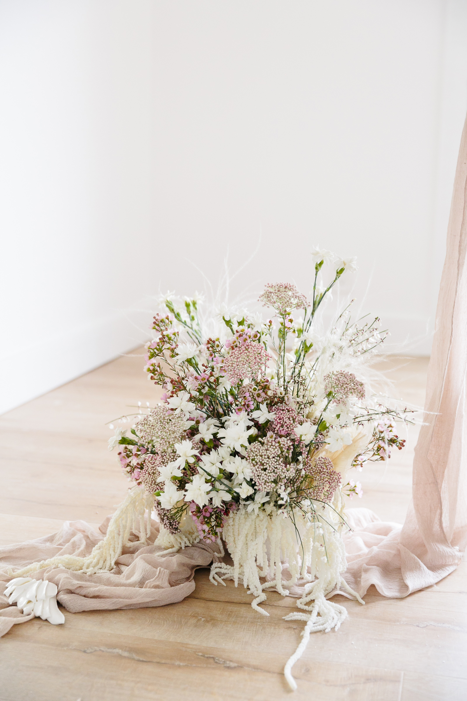 romeo and juliet valentines day party bouquet of white and blush flowers