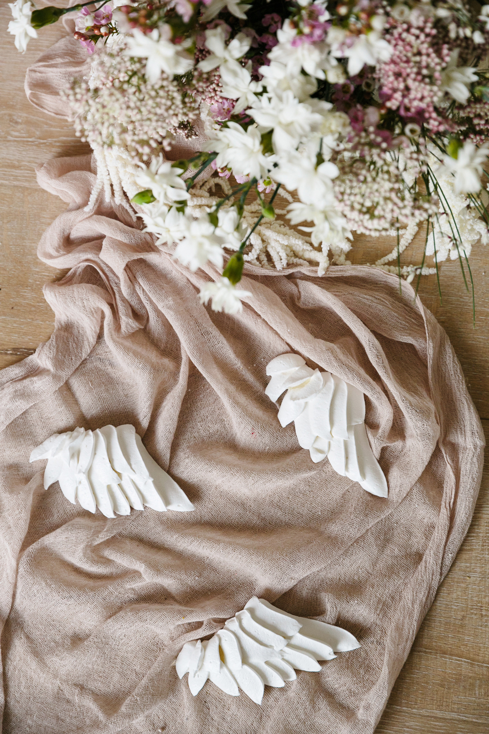 romeo and juliet valentines day party decorations angel wings and a white and blush bouquet