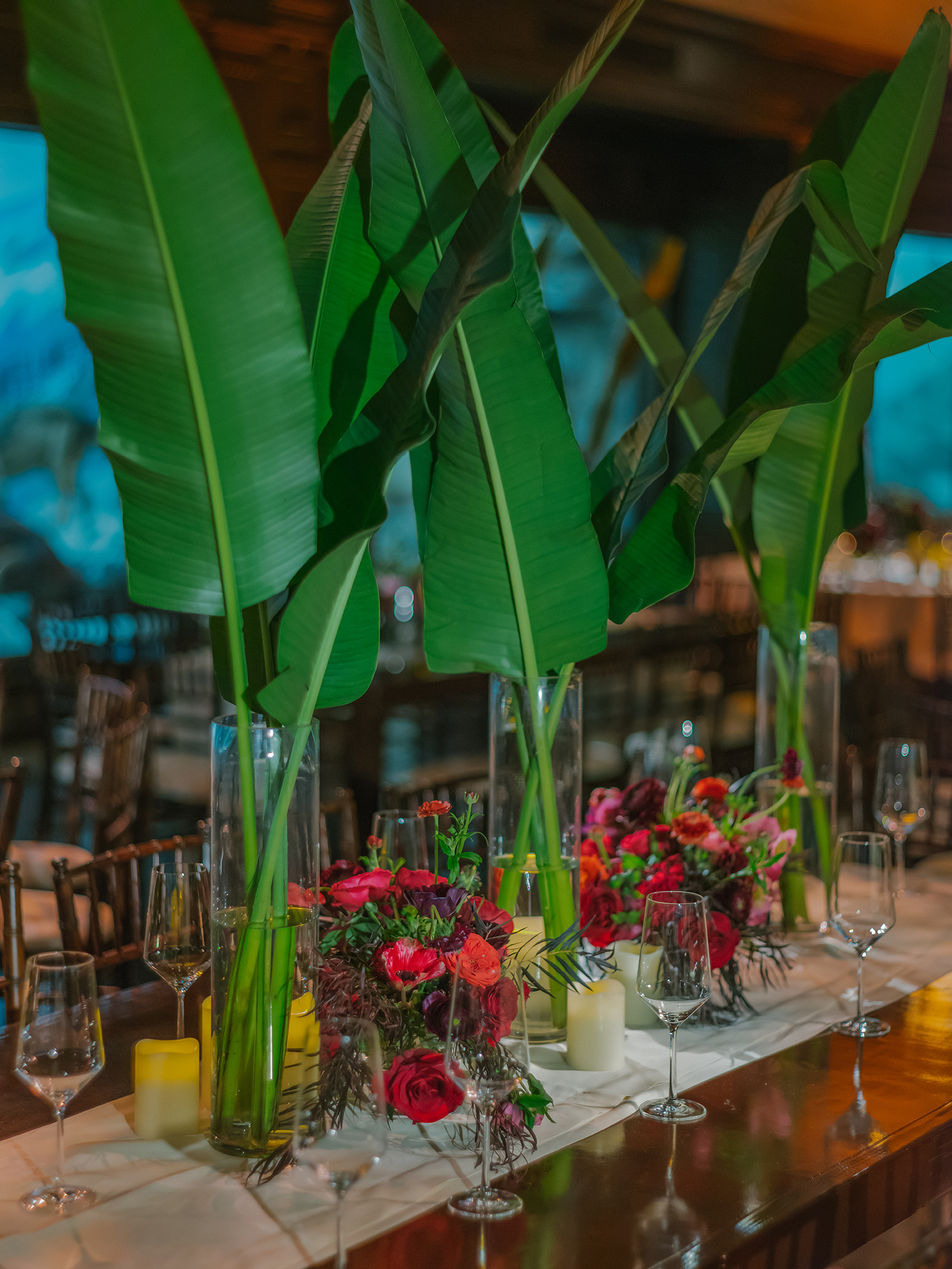duff goldman johnna colbry wedding centerpieces with banana leaves