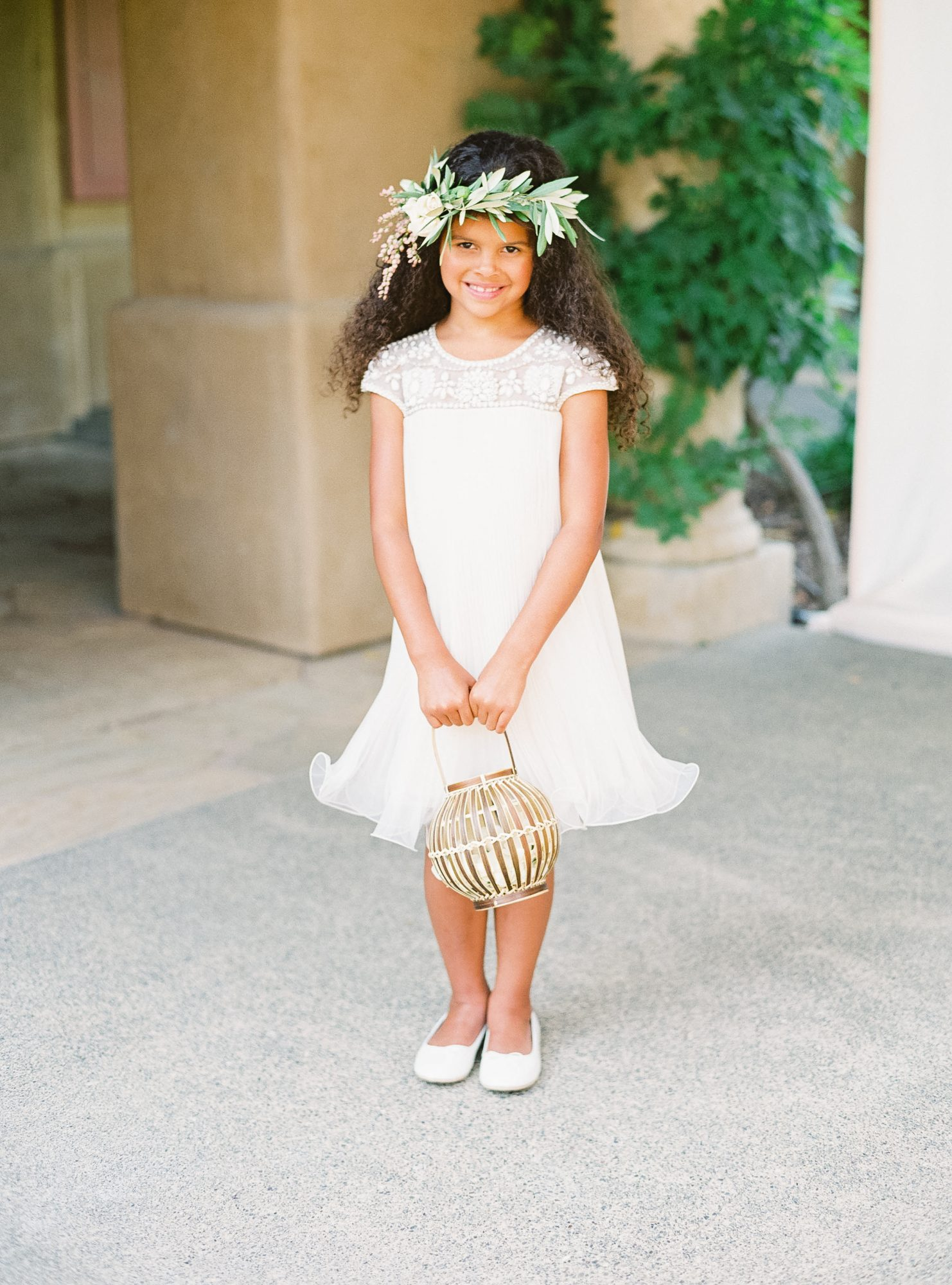 flower girl holding paper lantern inspired basket