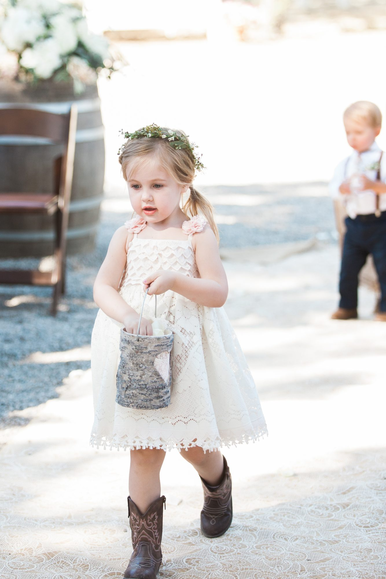 flower girl holding birch bark inspired basket