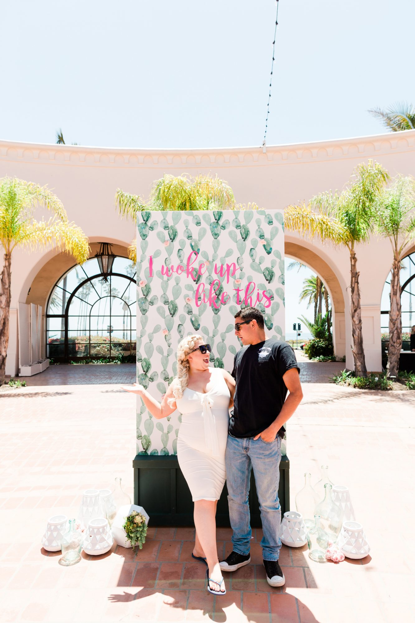 couple stands in front of brunch backdrop