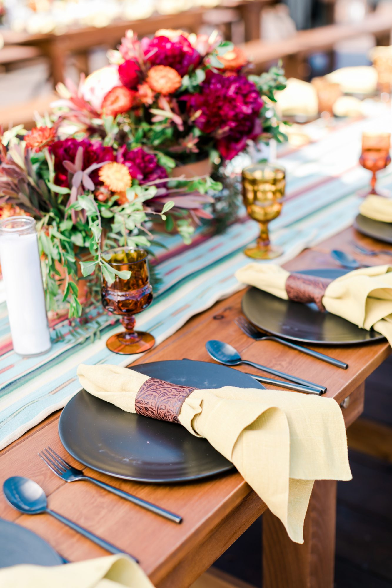 multicolor table setting with floral centerpieces