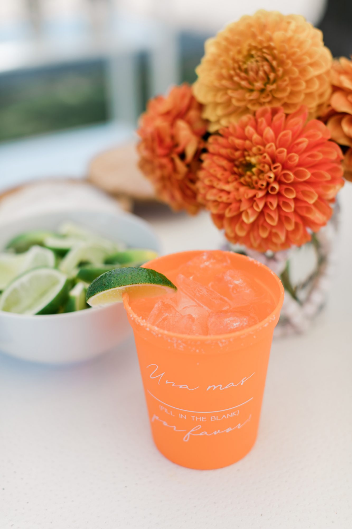 orange cocktail cups with white writing