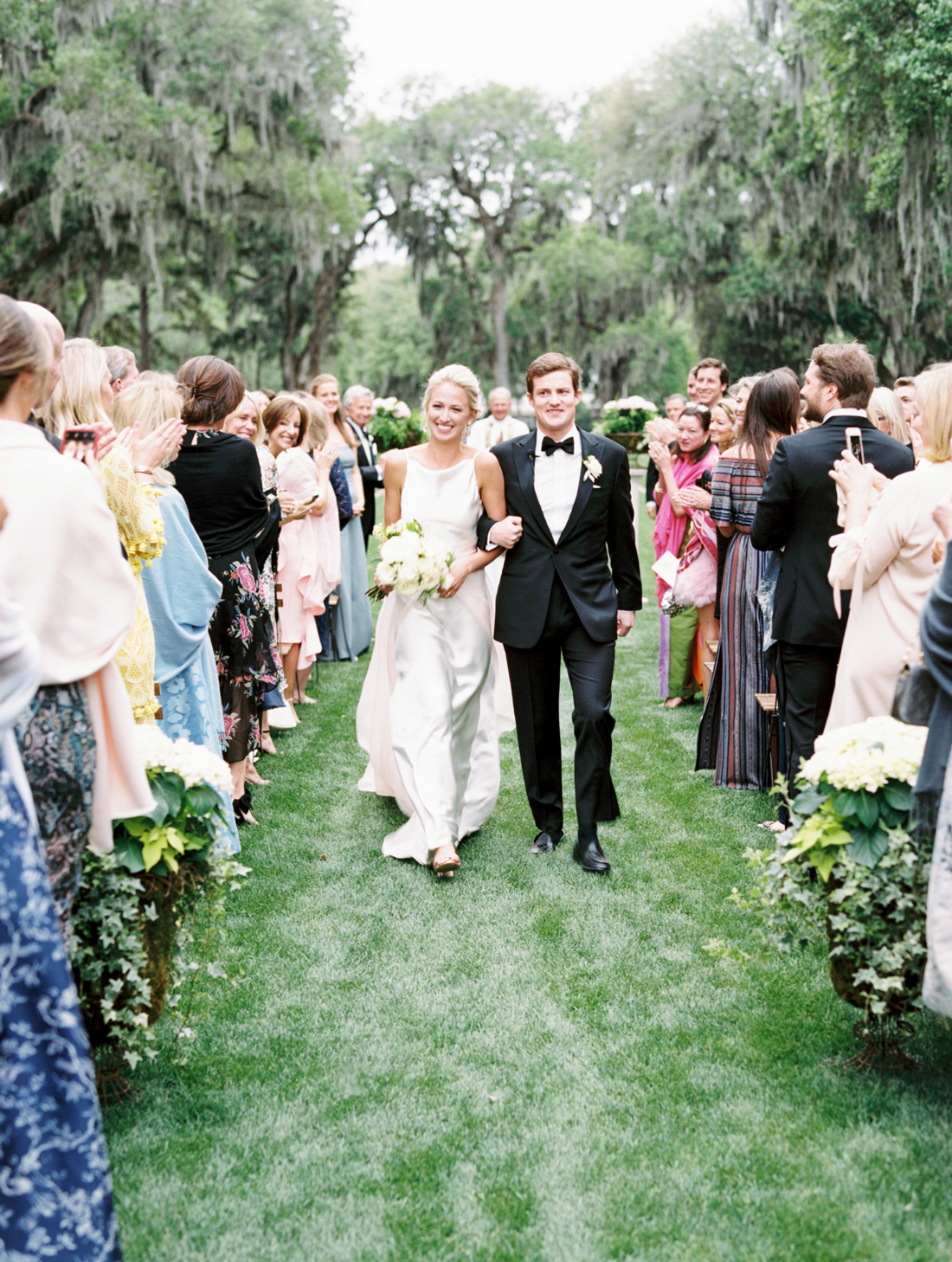 bride and groom walk down aisle during wedding recessional