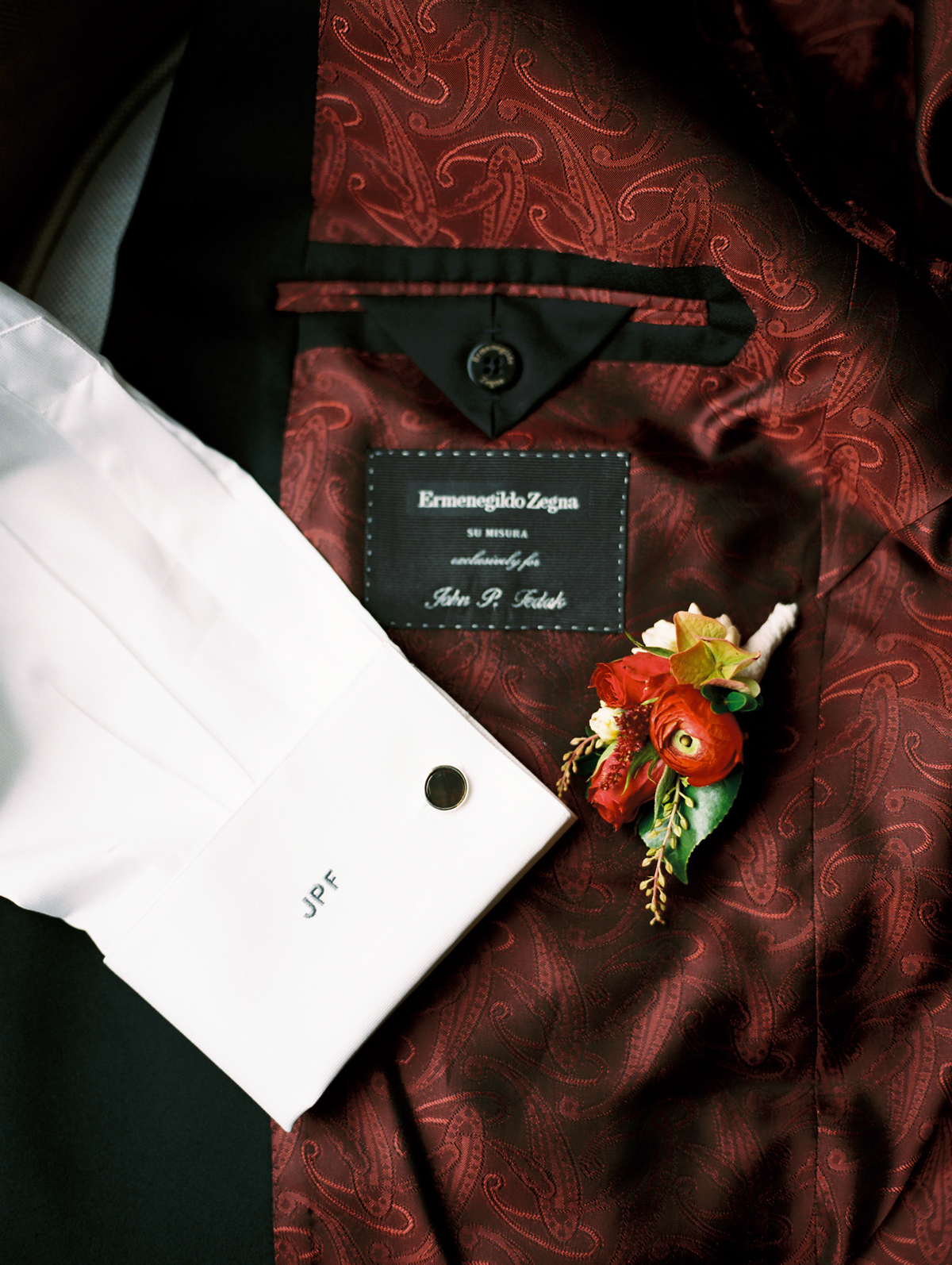custom made red print lining tuxedo with monogram on sleeve