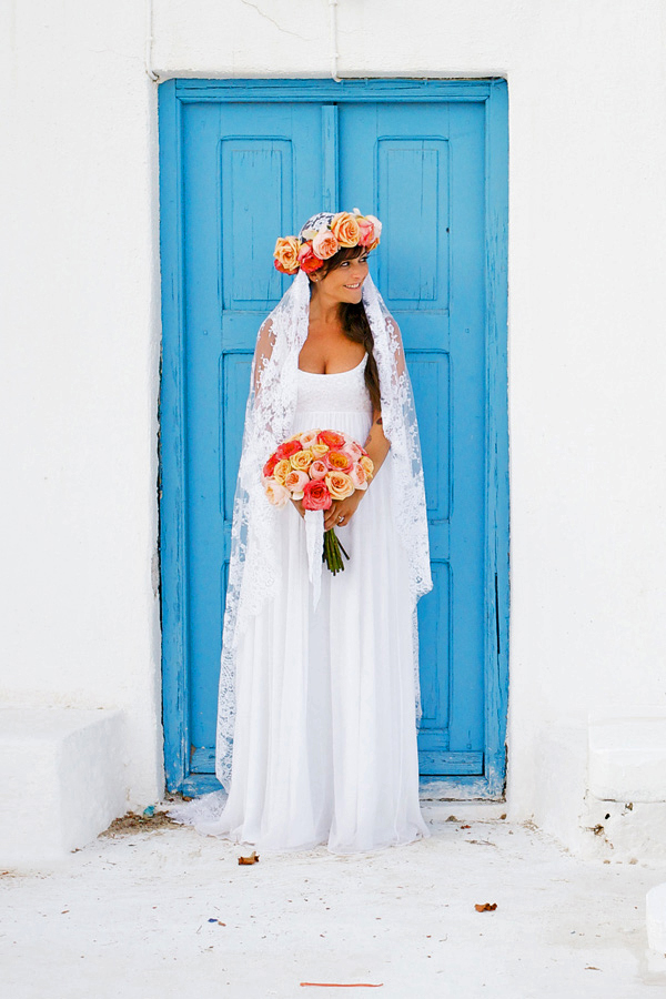 unique wedding color palette bride in front of bright blue door