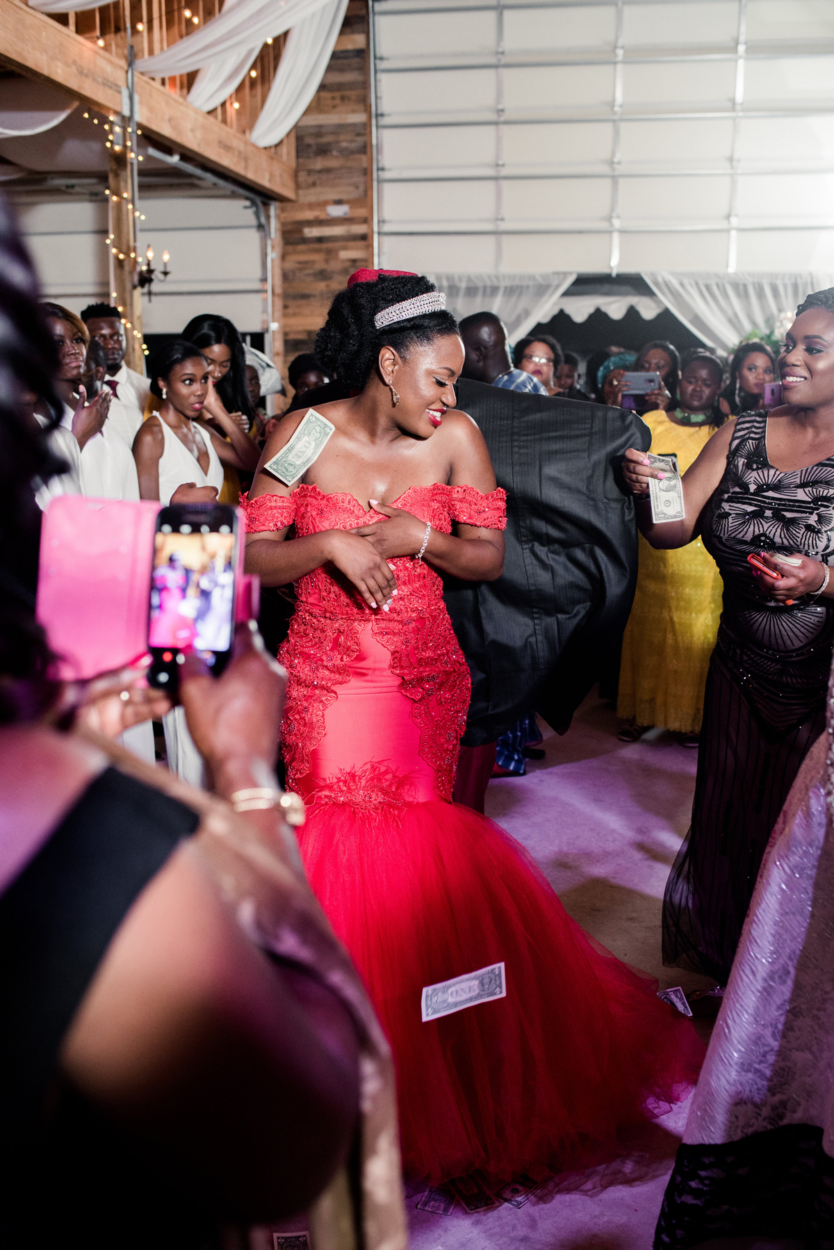 bride dances while guests shower her with money