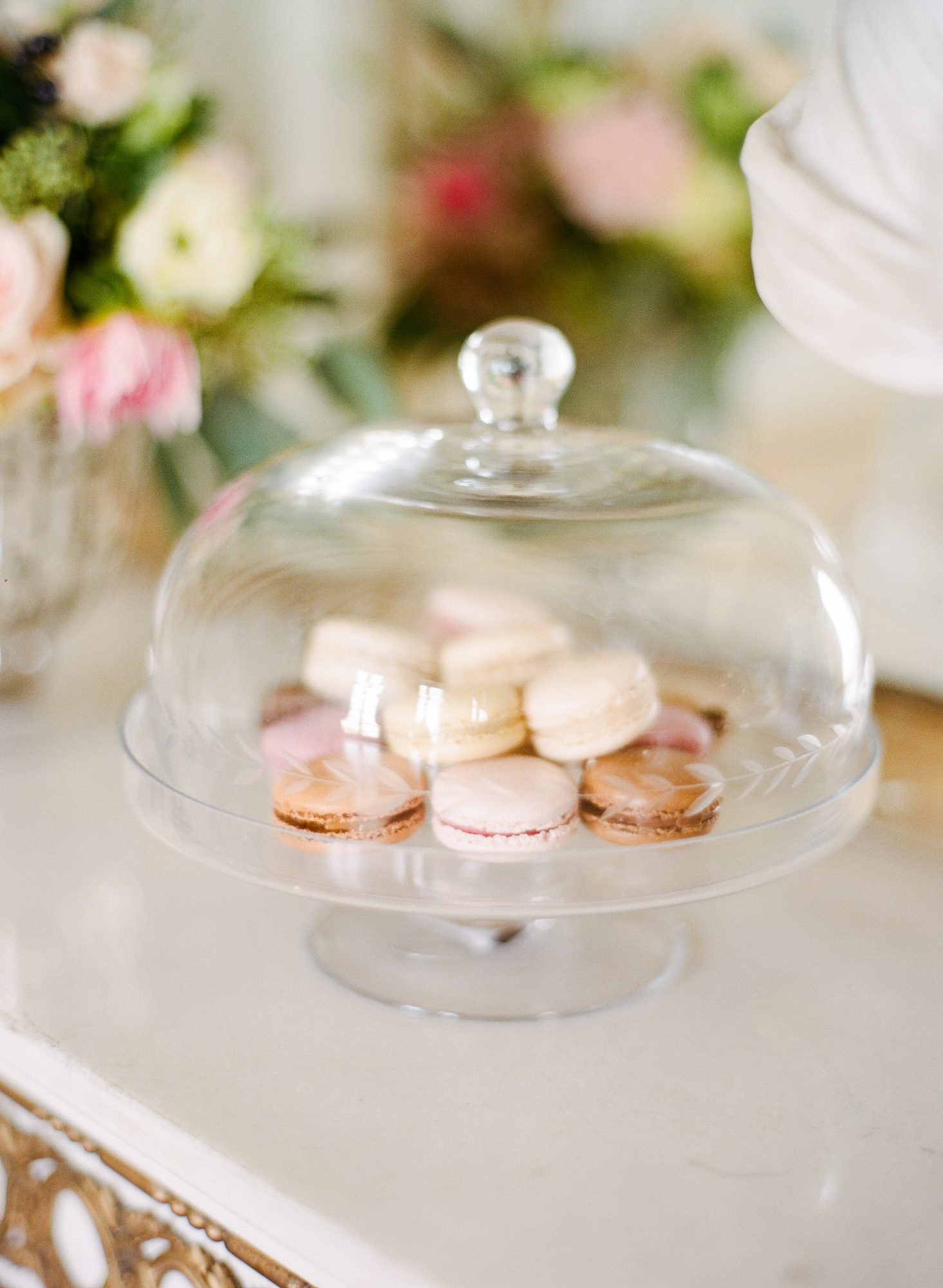 assorted macarons under a cloche