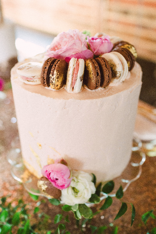 wedding cake topped with macarons